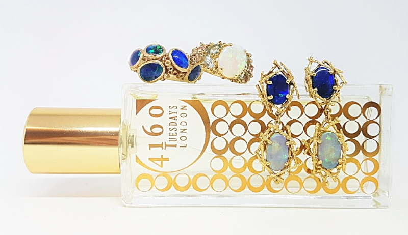 Opal Lights is one of two limited edition Opal Inspired fragrances made by 4160 Tuesdays for Fire & Facets exhibition.  Pictured here with ring by Ami Pepper, Ruta Reifen and earrings by Alex Monroe