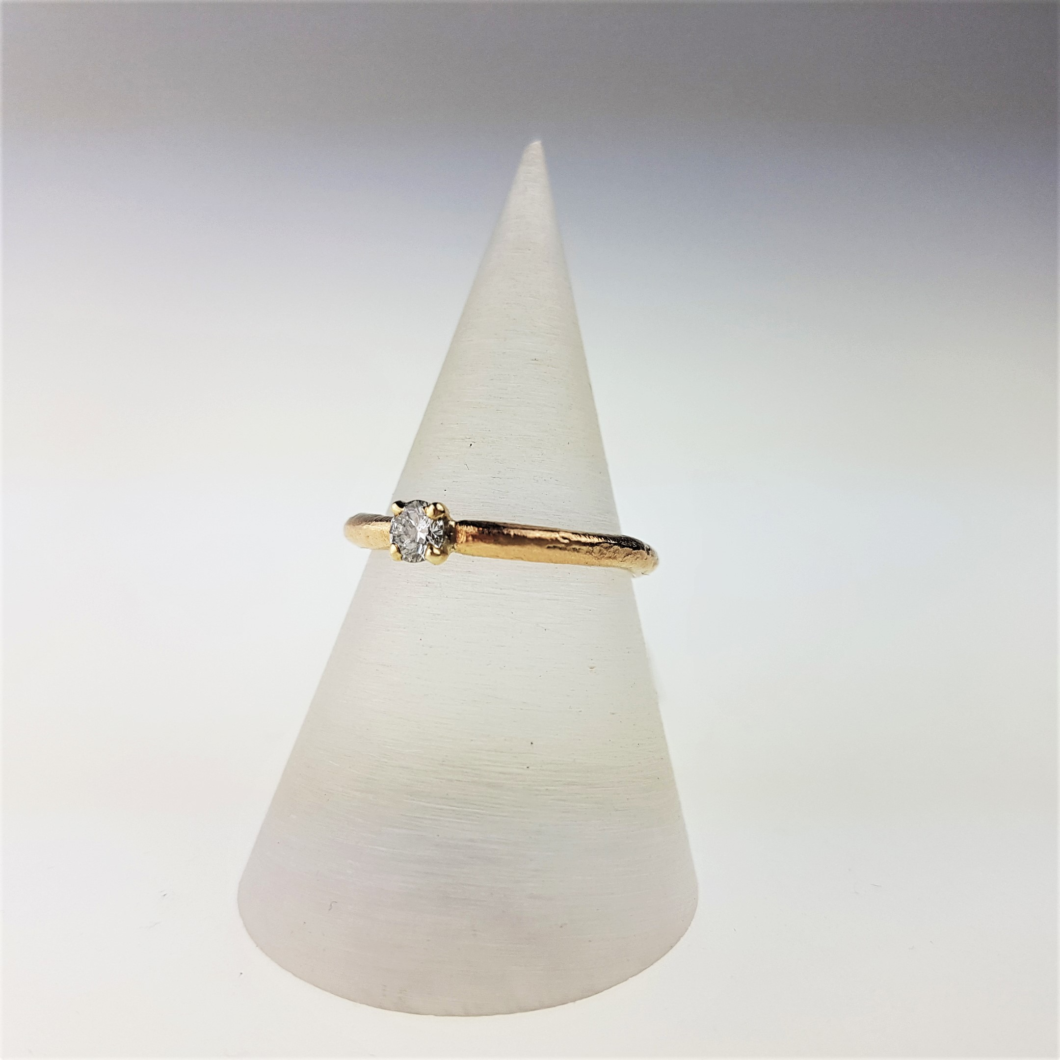 Beach Memories - This claw set diamond ring is £1170 made by Justin Duance in 9ct gold with a 3.5mm white diamond. The Cornish jeweller creates his natural texture by casting in sand. We can even personalise your wedding rings by using your own sand or from your favourite beach in Cornwall, just get in touch!