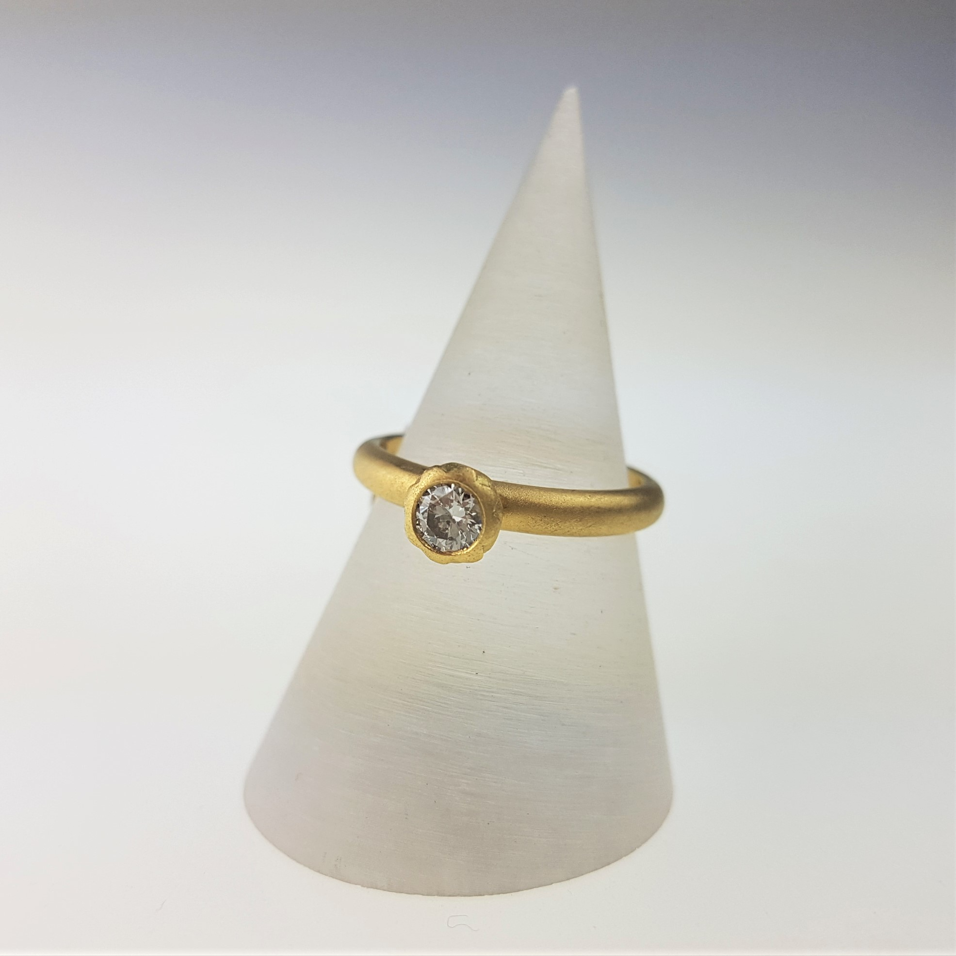 Floral & Feminine - Victoria Walker draws on the intricacies of nature seen in her kinetic flower lockets, and also in the petal shapes of her solid gold and diamond rings. This solitaire diamond is modelled on a stylised poppy head in 18ct yellow gold, £1585, handmade in Cornwall.