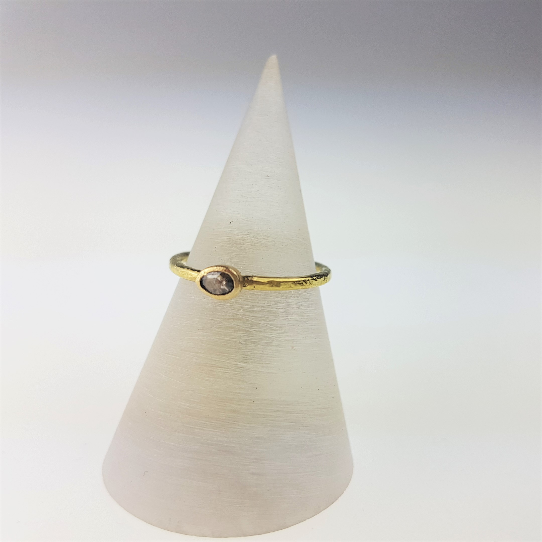 Indian Treasure - Poppy Dandiya is known for his sumptuous gems inspired by the rich colours of India where he has now retired from jewellery making. In his final collection available at Gill Wing, he also made a rare few diamond rings including this dainty brown rose cut diamond on a hammered 18ct yellow gold band, £475.