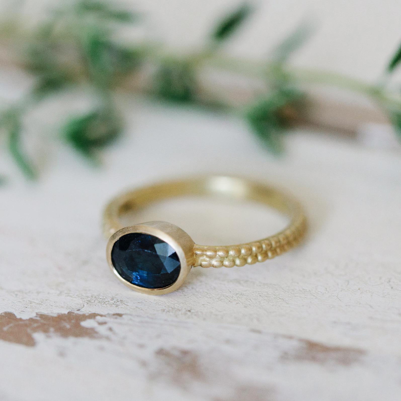31 Madagaskan sapphire Coupled Dotty Ring main.jpg