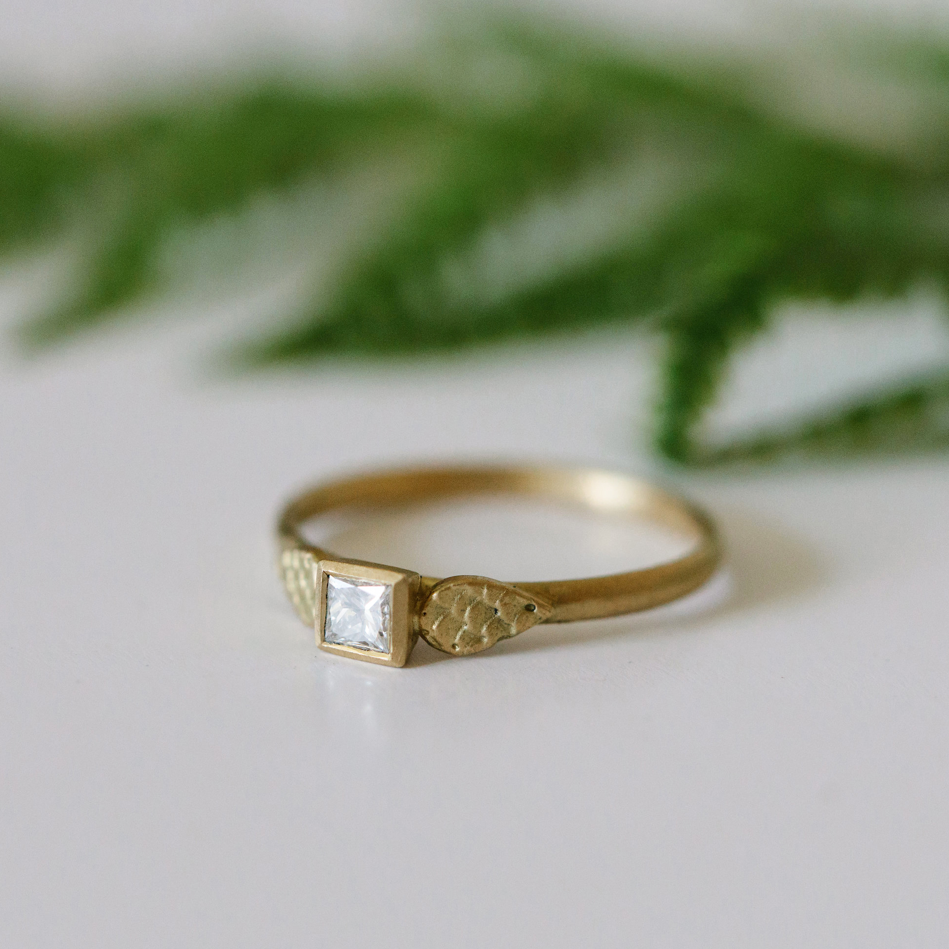 Delicate Details - Natural charm from this square cut white diamond with an 18ct yellow gold catkin motif inspired by the delicate nature inspired motifs found in antique rings. Handmade in Scotland by Alison Macleod available at Gill Wing Jewellery.