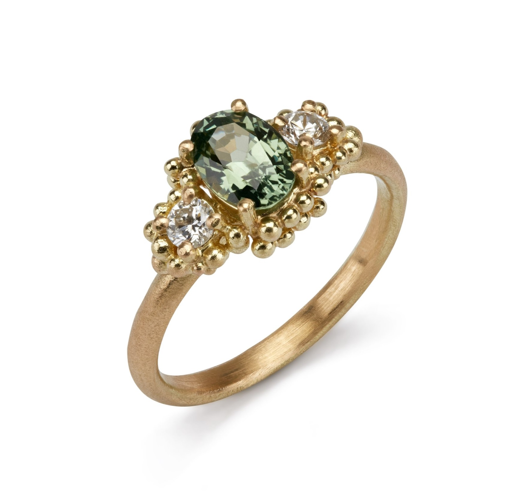 Ethical Gemstones - This luscious green sapphire and diamond ring by Hannah Bedford is waiting for you at Gill Wing. Featuring the granulated gold detail, the precious sapphire is a beautiful choice for those wishing for a little colour in their engagement ring.