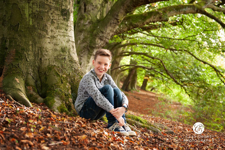 boy in woods in autumn