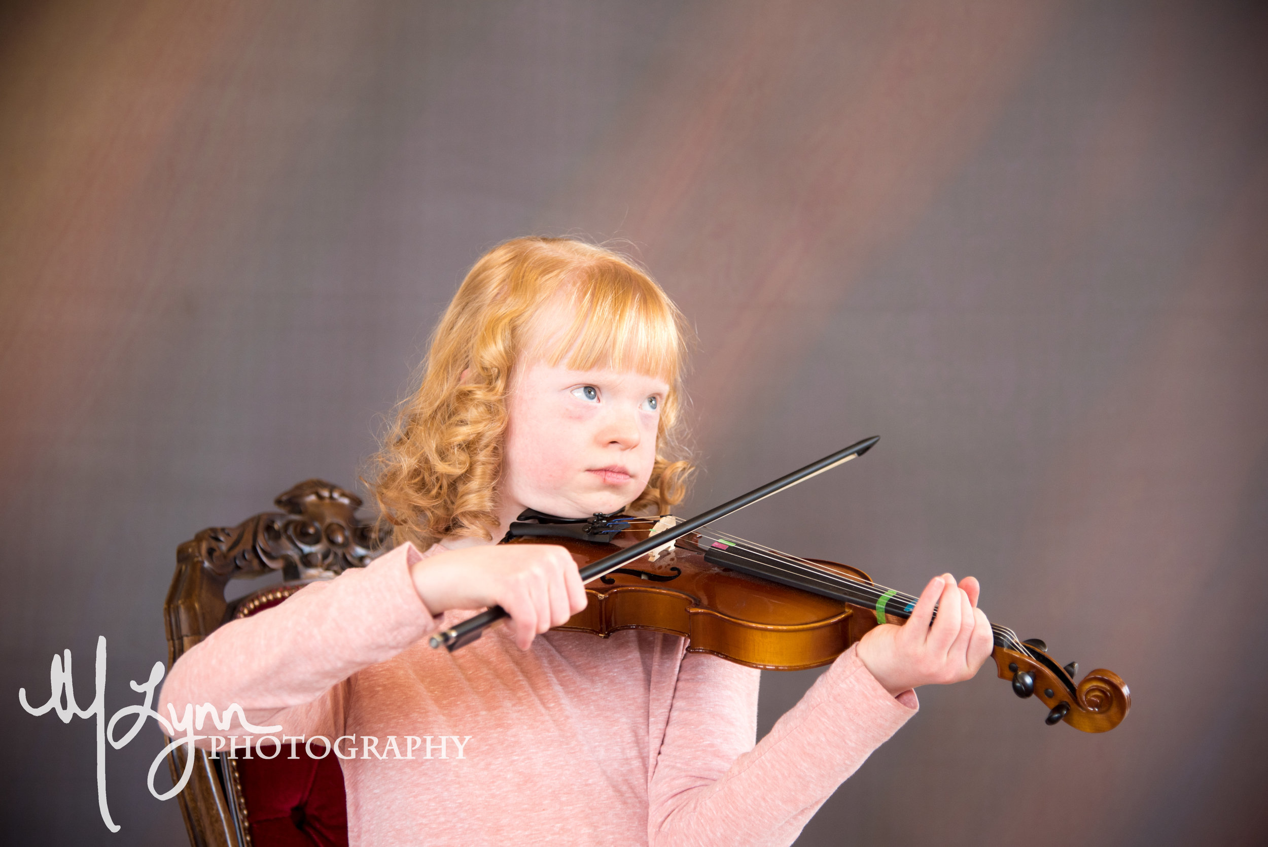 fine art children's portrait blonde girl playing violin