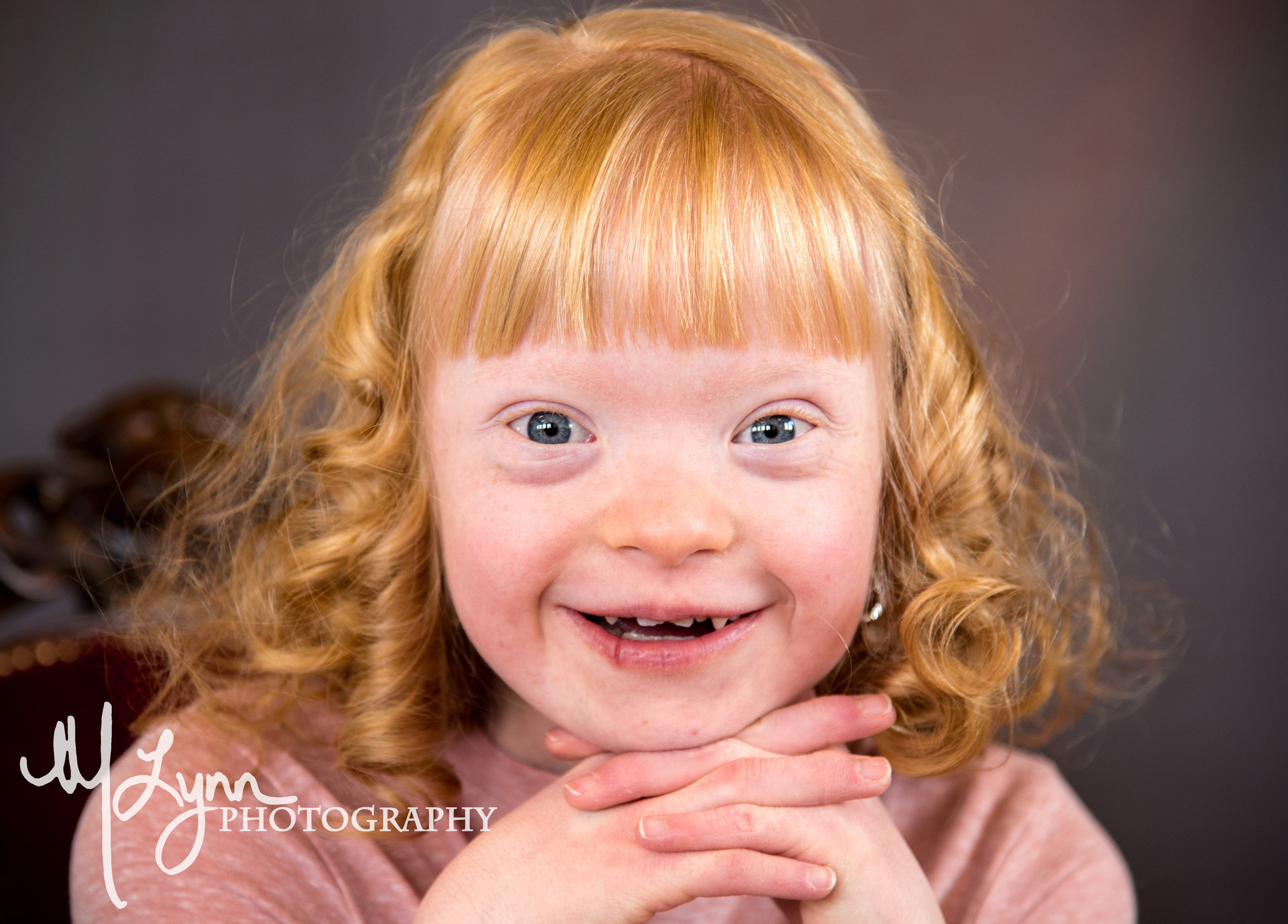 fine art portrait of blonde girl blue eyes