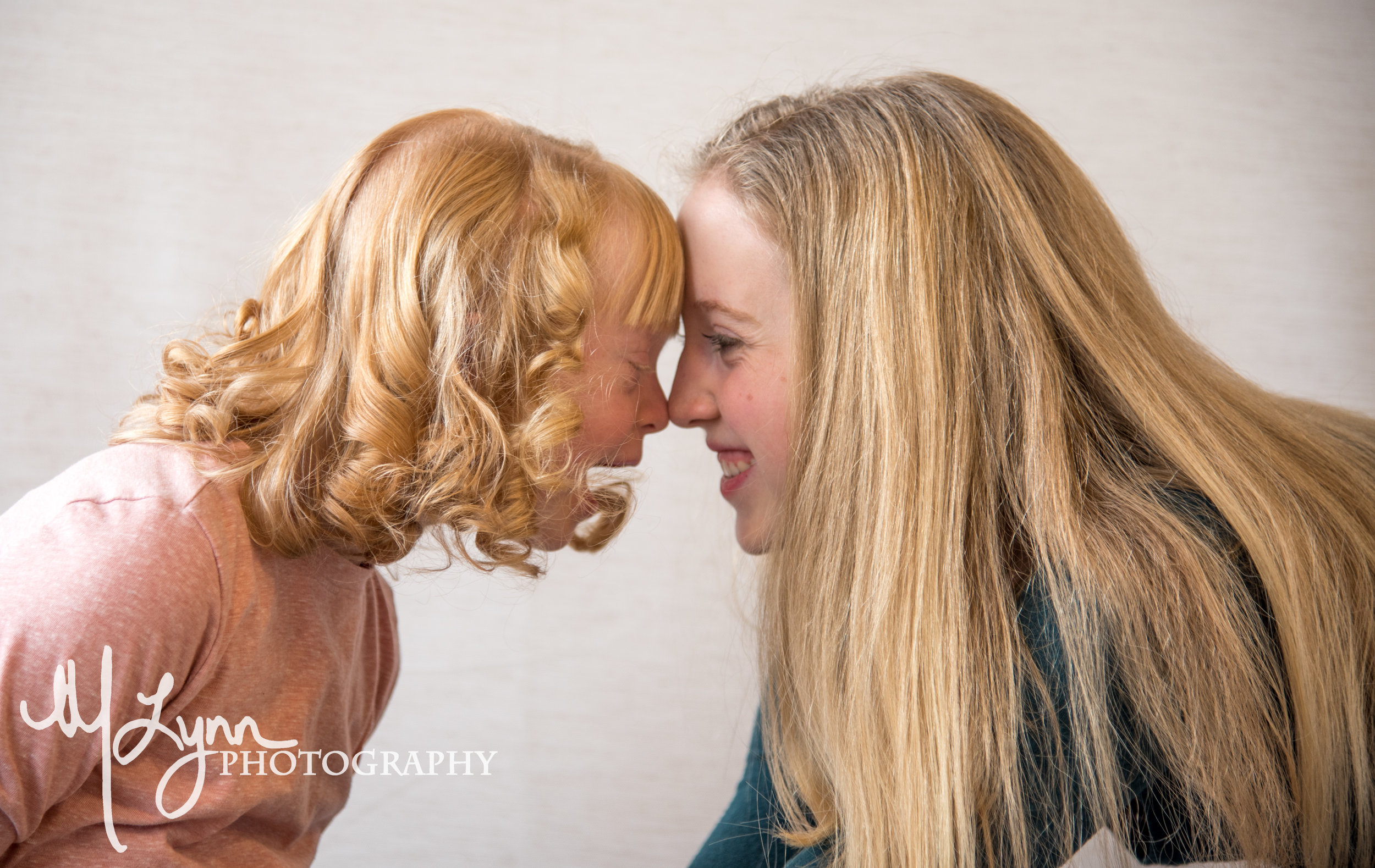 sisters rubbing noses