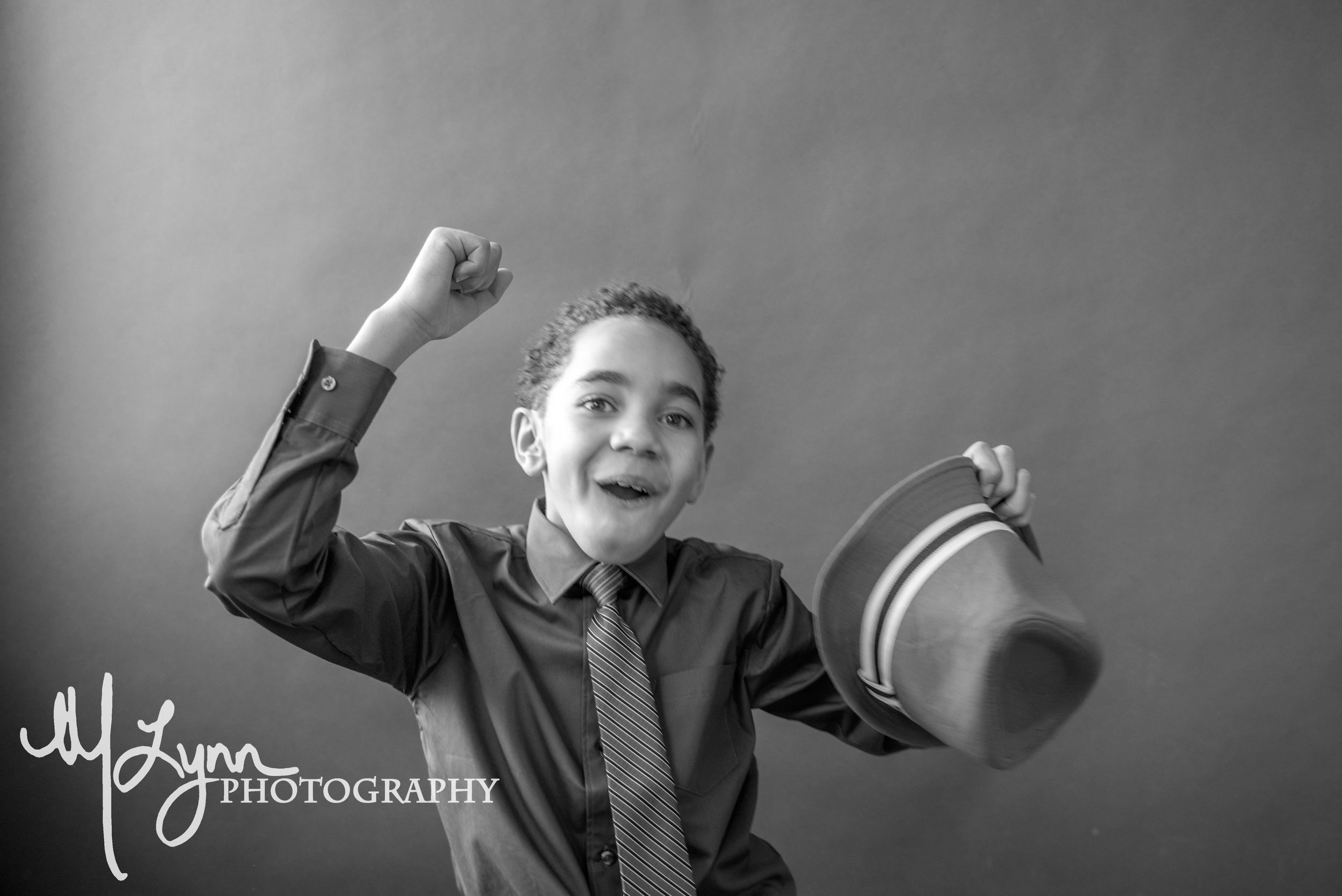 black and white fine art child portraits silly dancing candid personality.jpg