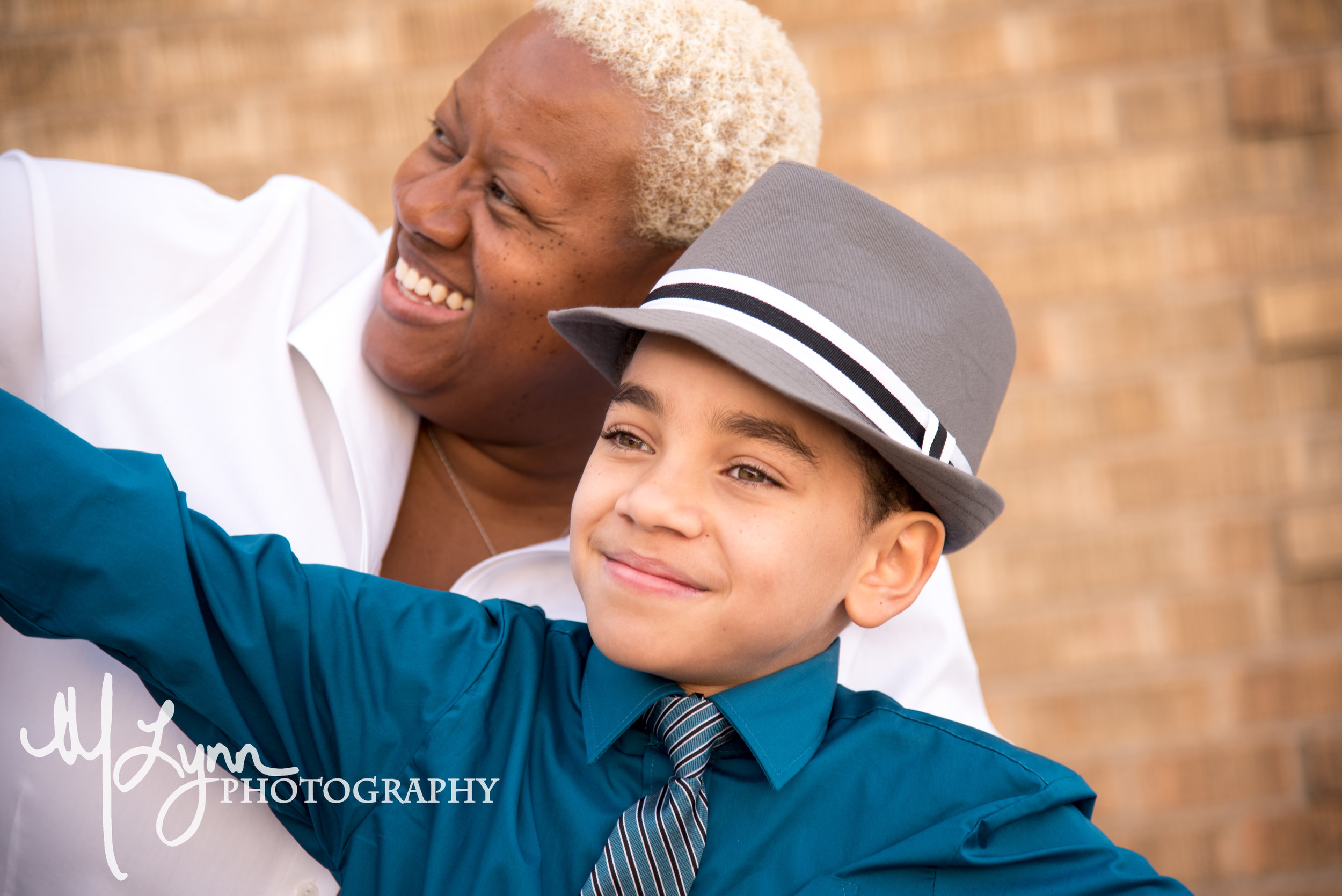 mother son candid silly brick formal head shot.jpg