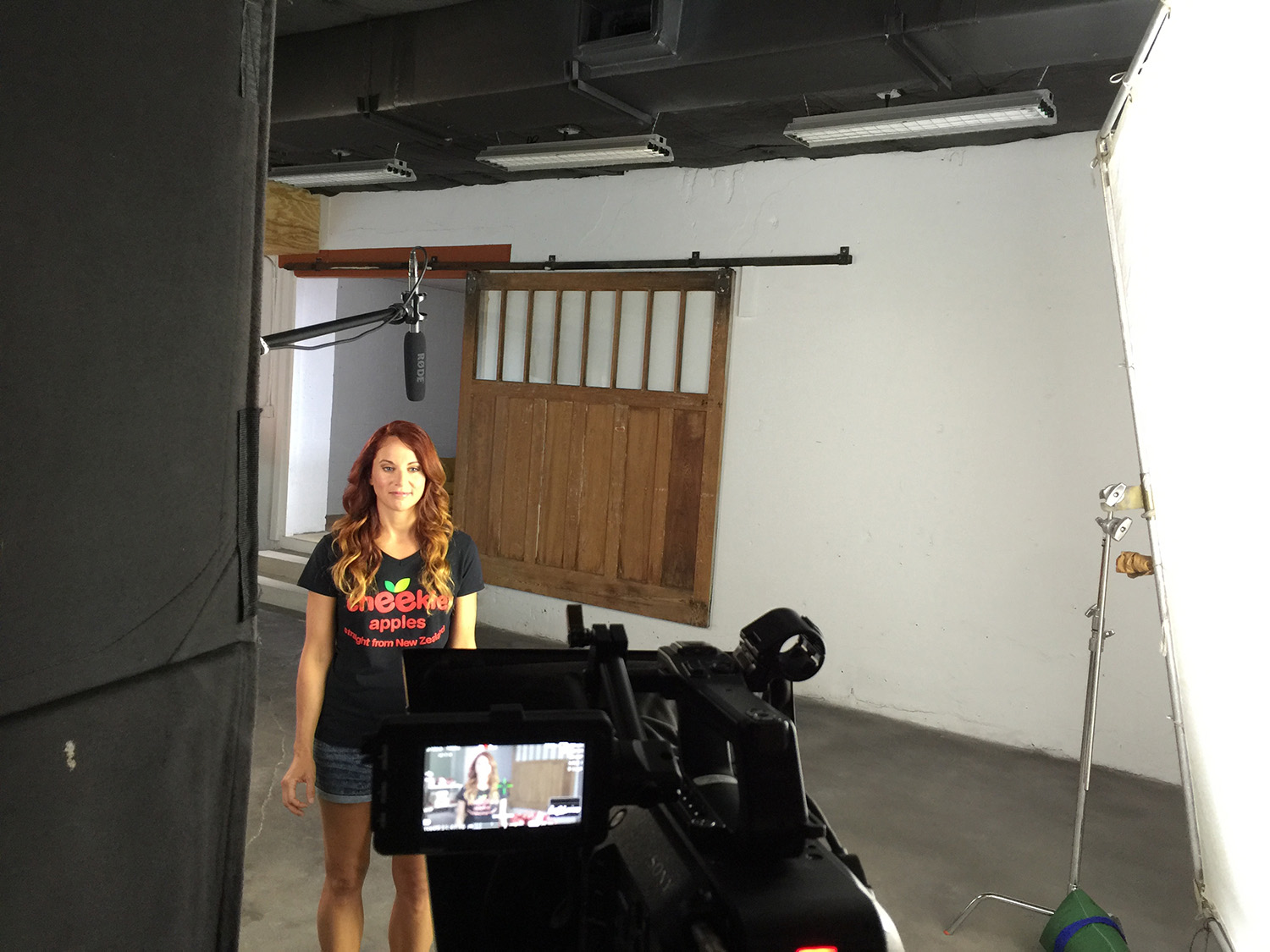 Using the features of the studio for a background for a commercial.
