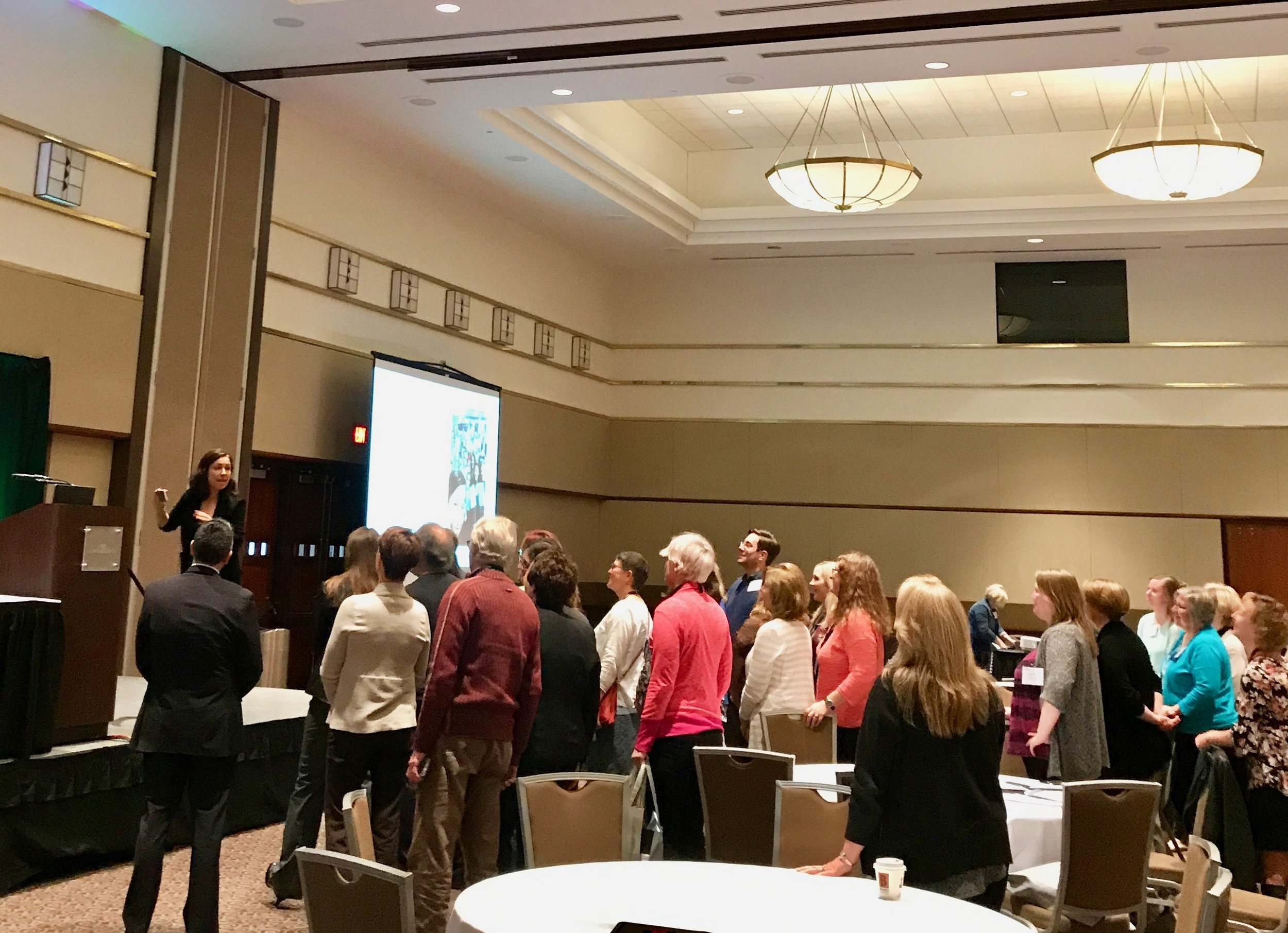 Manoush rallying the crowd for a selfie at the Michigan Library Association conference, in Lansing, MI. during her October book tour.