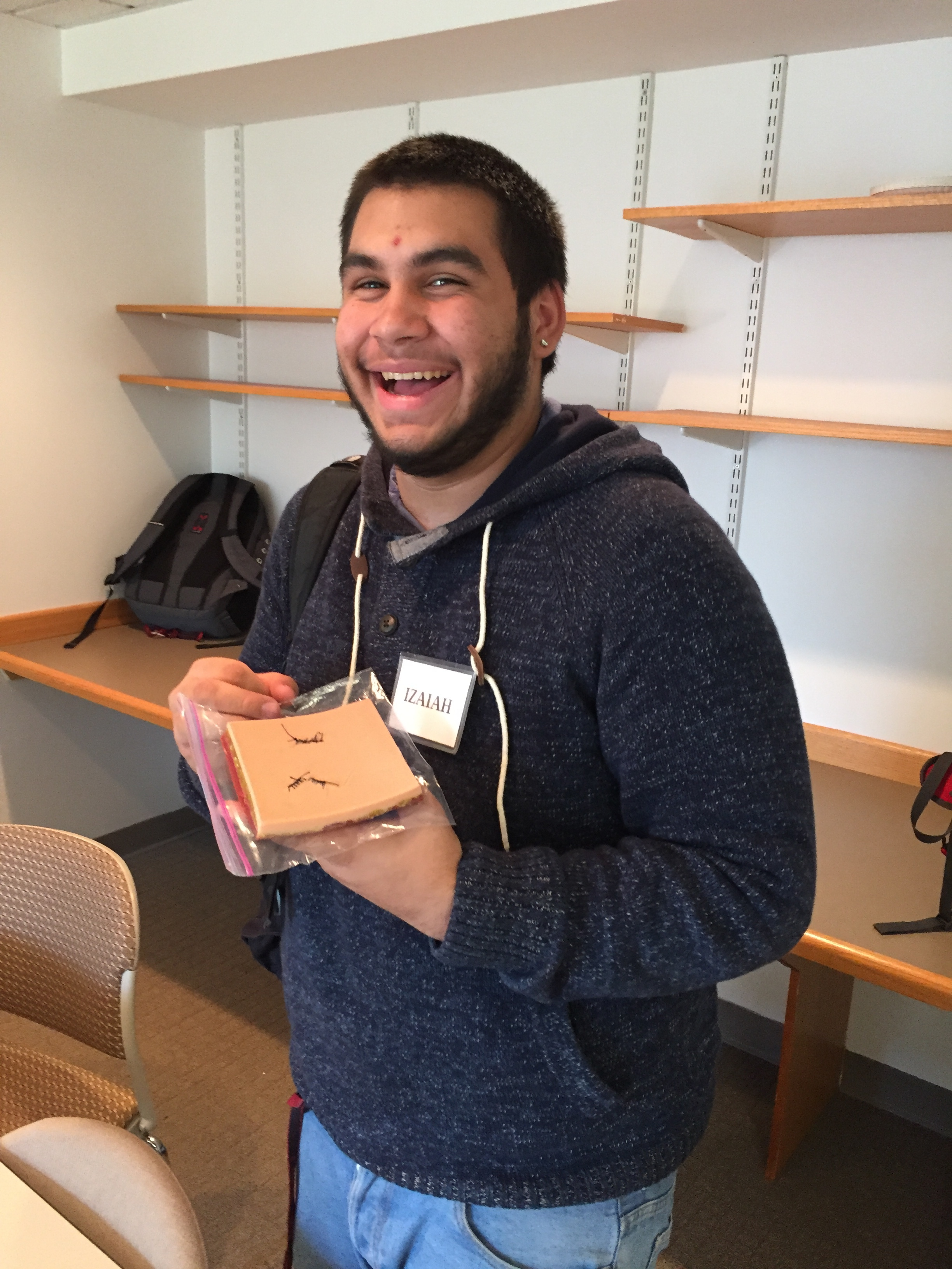 Izaiah, Urban Science Academy senior, proudly displays his suturing skills