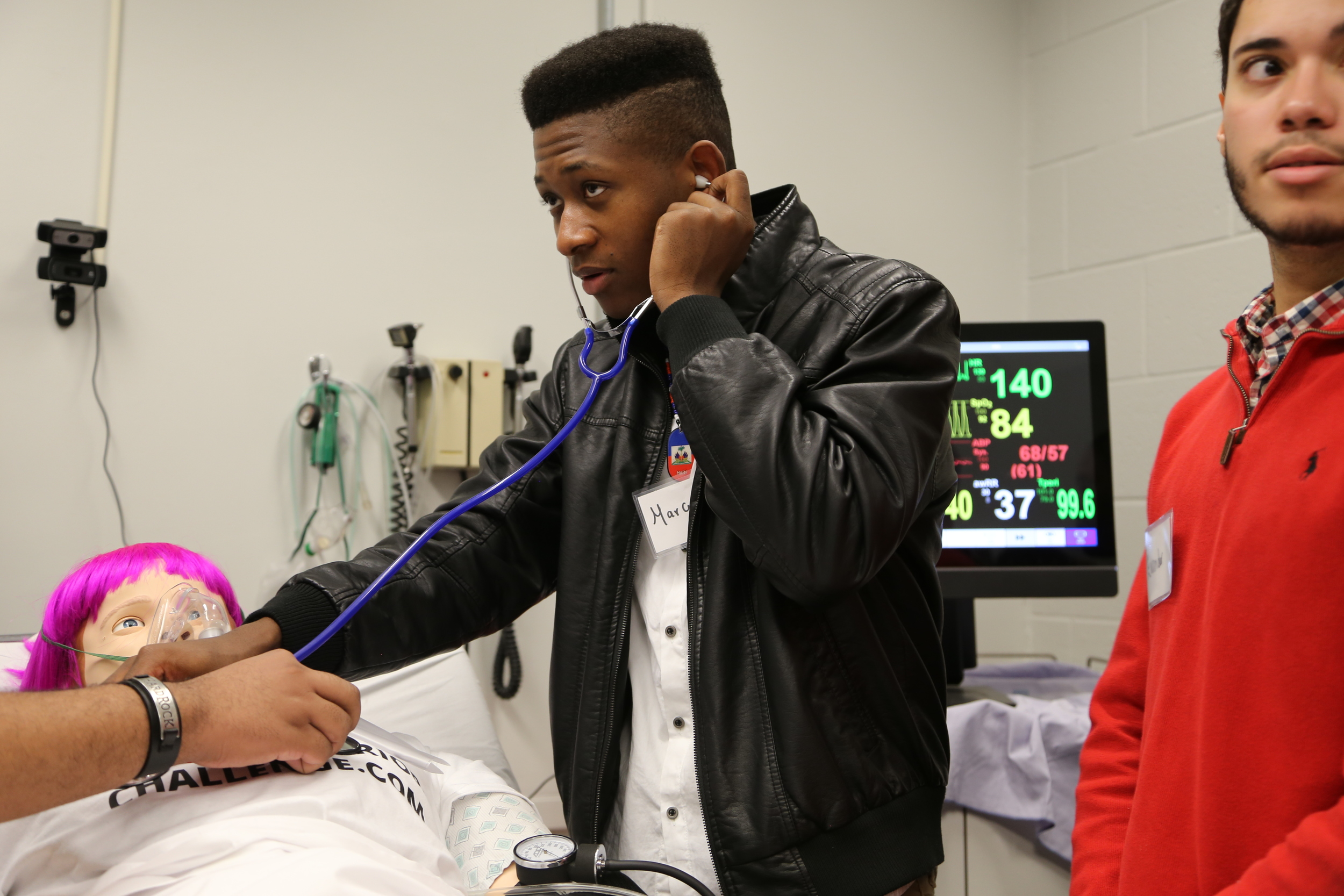 Marcus, Community Academy of Science & Health senior, listens for lung sounds