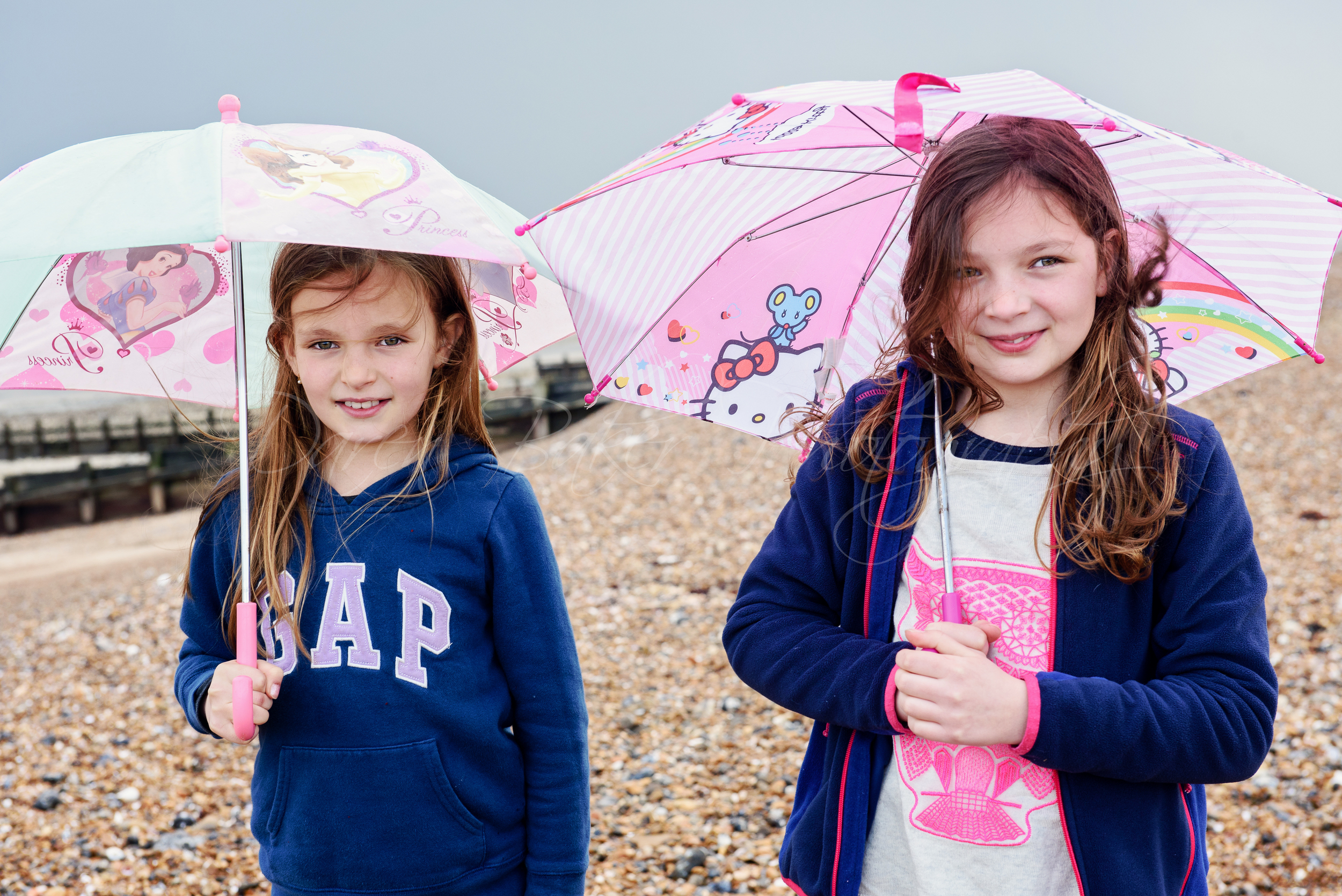 Umbrellas and girls, beach shoot,, Ferring Sussex