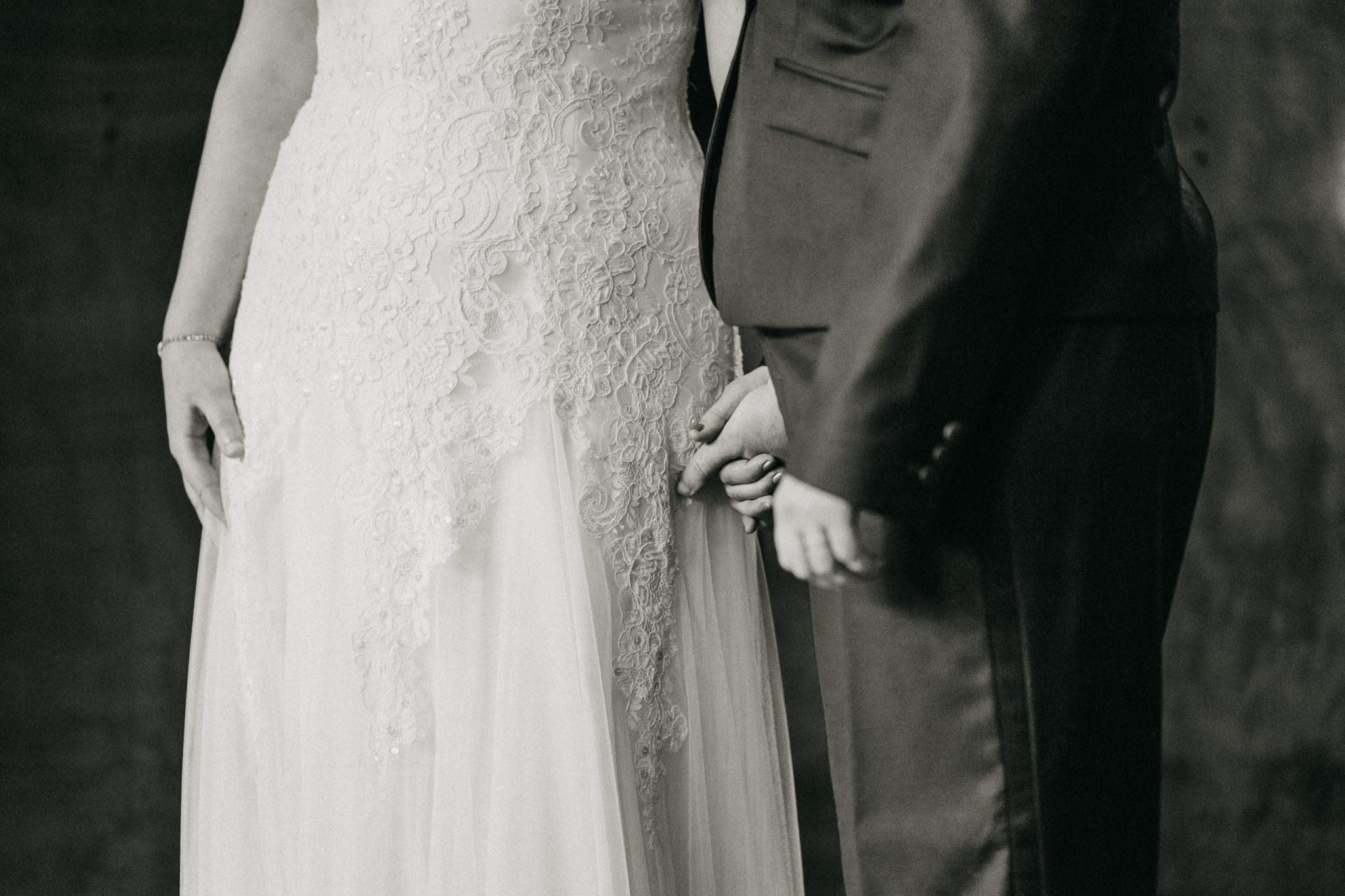 Black white Brides Hold Hands Seattle