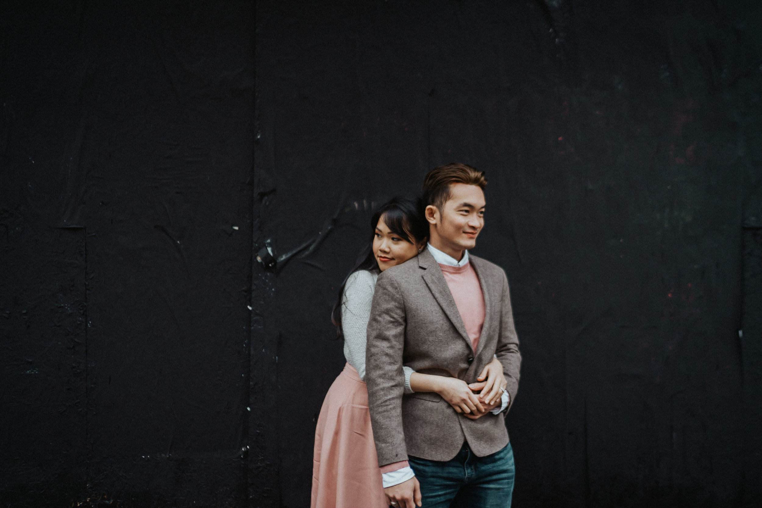 fashion engagement photography black wall