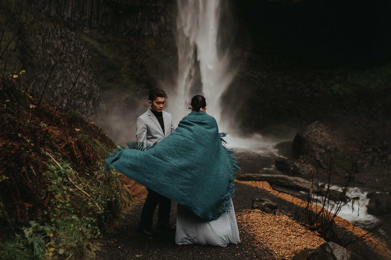 Dramatic moody engagement waterfall photography