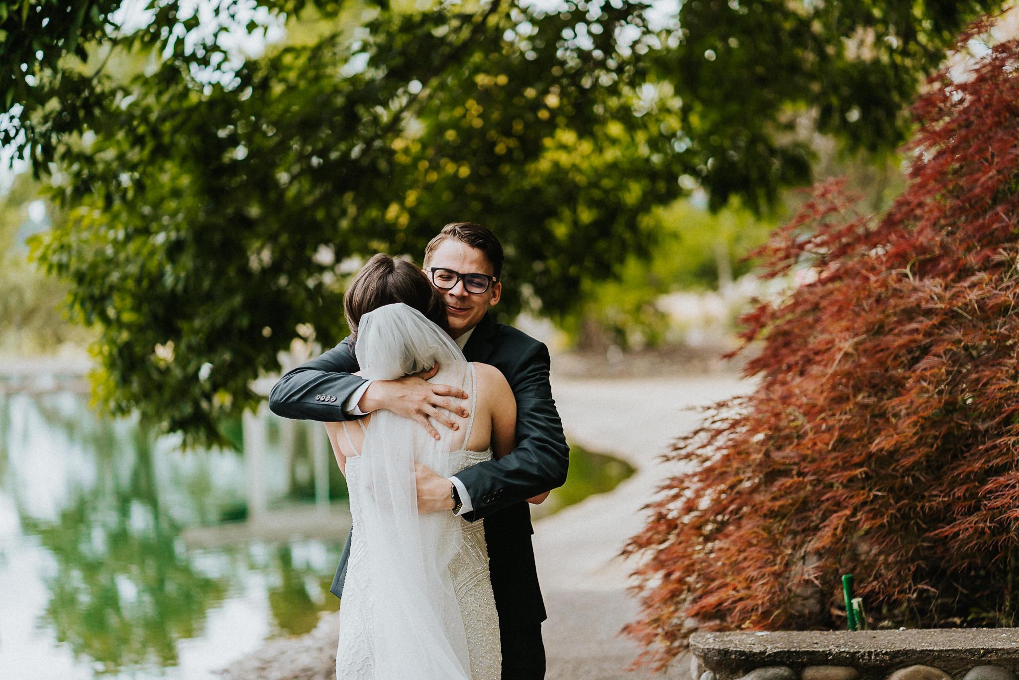 Beautiful Groom hug Bride First Look Newberg Wedding Alfred Tang