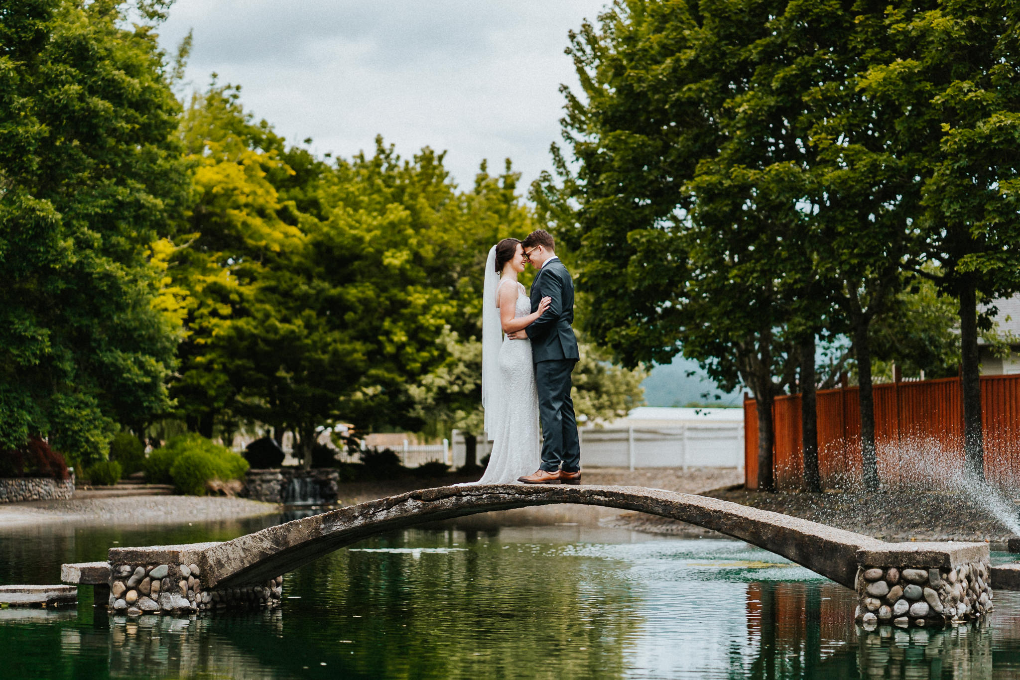 Water Oasis Bridge Fountain Bride Groom Portrait