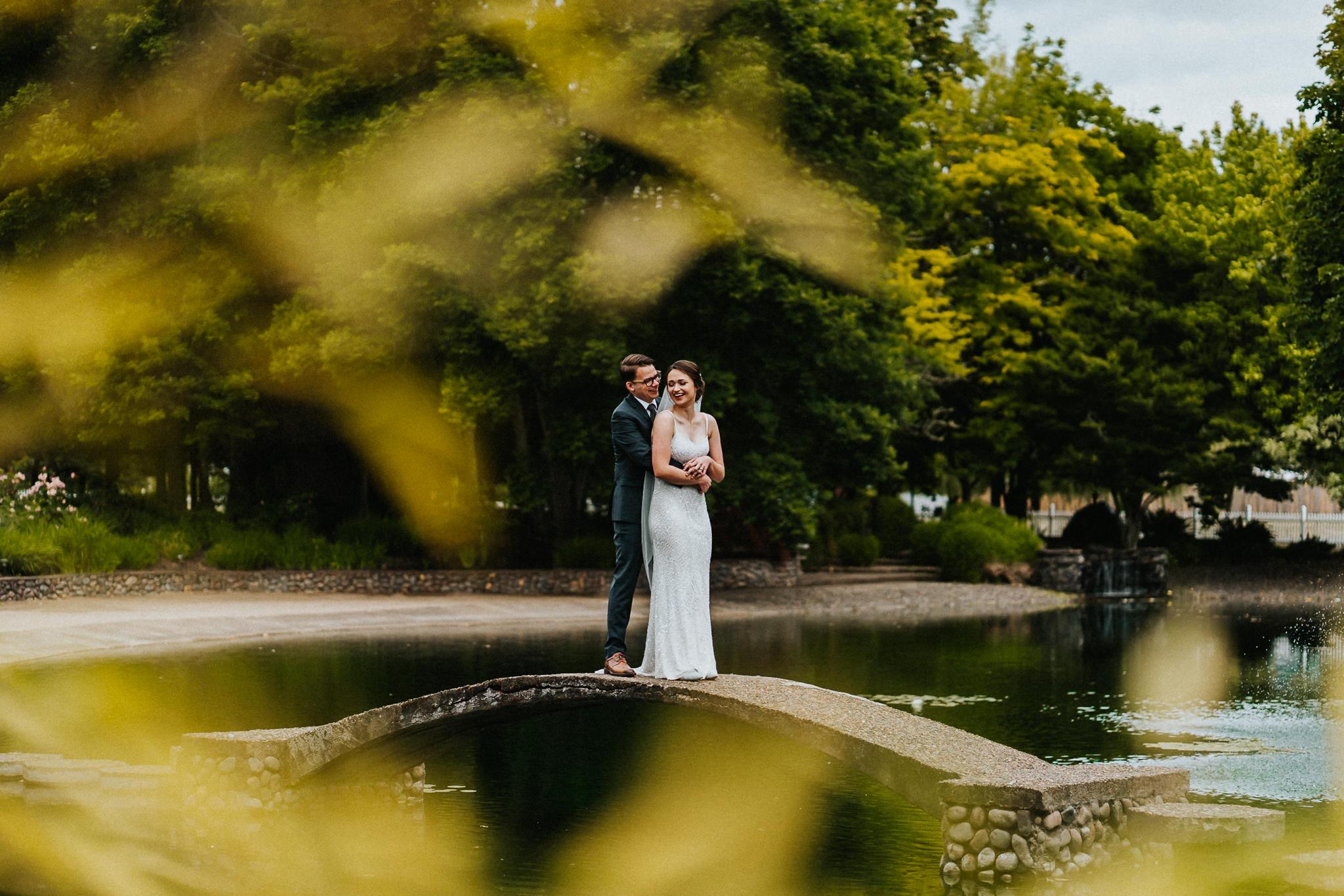 Dark Moody Wedding Portrait Bride Groom Bridge Water Bamboo Leaves