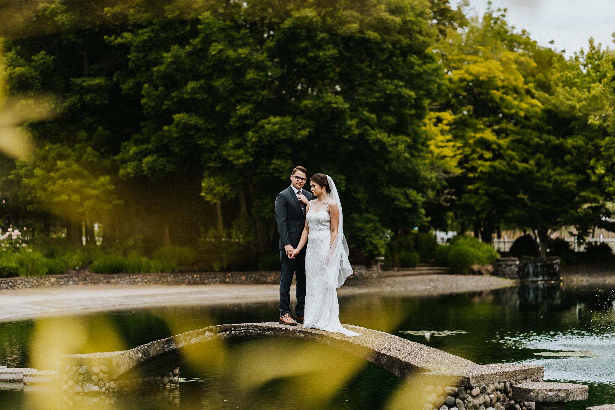Dark Moody Wedding Portrait Bride Groom Bridge Water Stoic