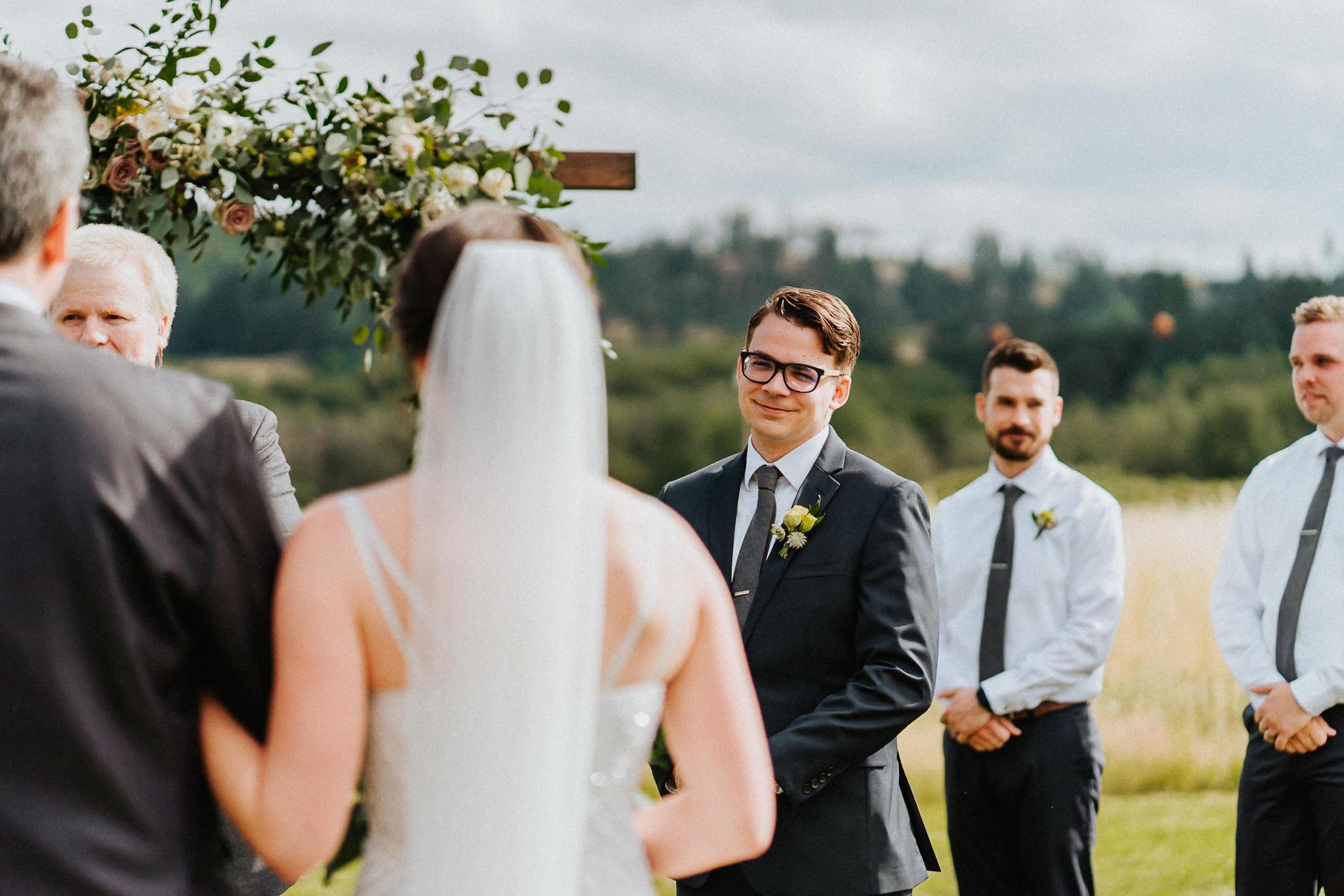 Groom Candid smile bride alter Water Oasis