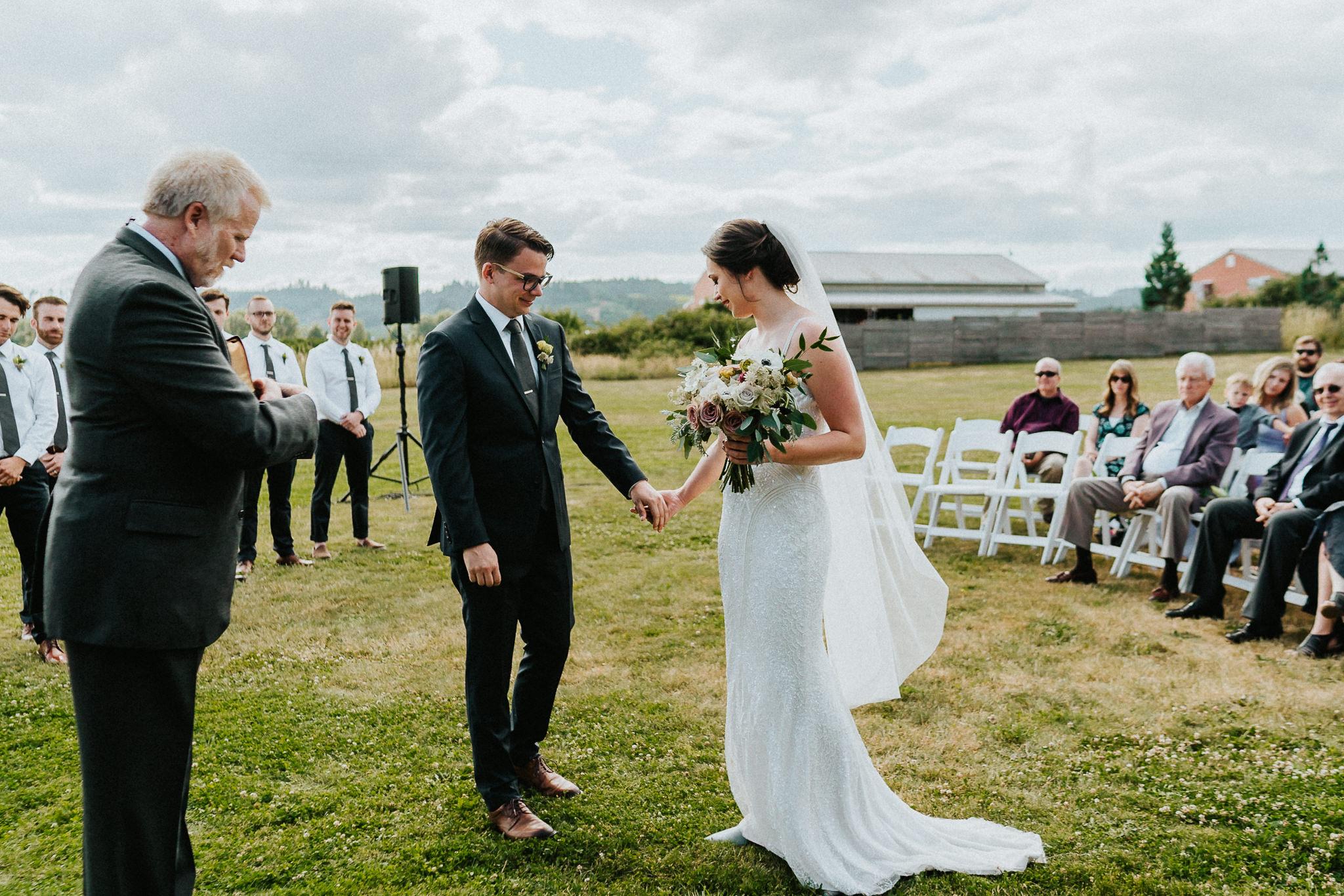 Groom receive bride Wedding Photography Alter Water Oasis venue