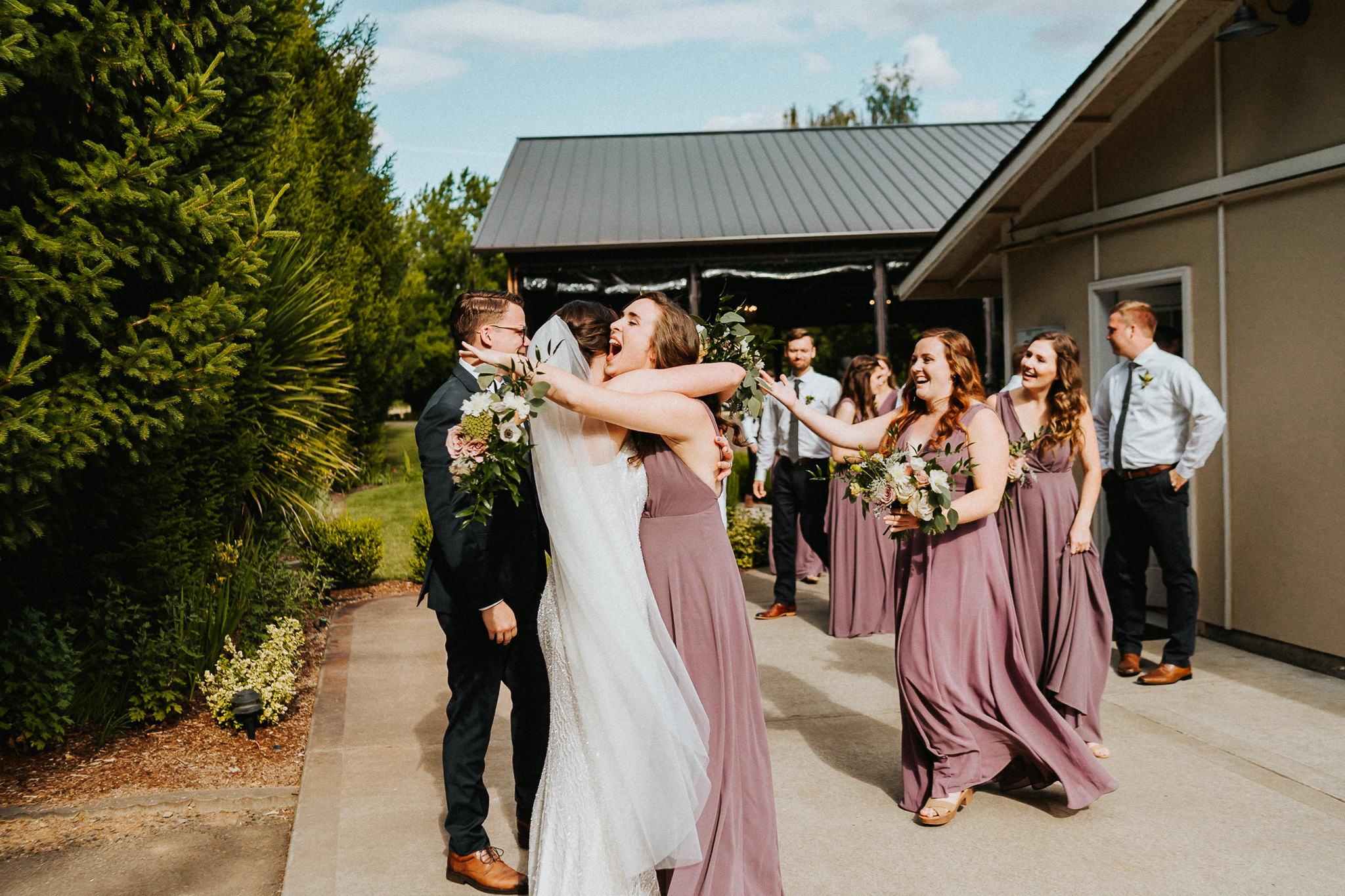 Celebrate wedding party hugs bridesmaid Wedding Photography
