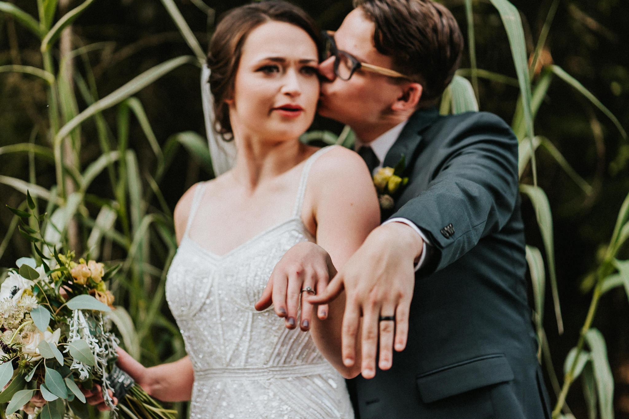 Show off wedding ring bride groom Portland Photography