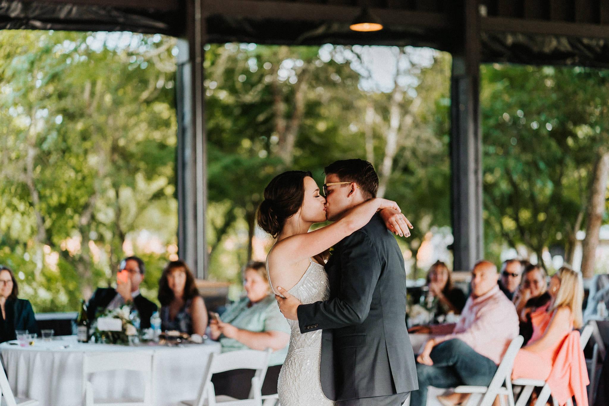 First Dance Kiss Water Oasis Wedding Natural Light