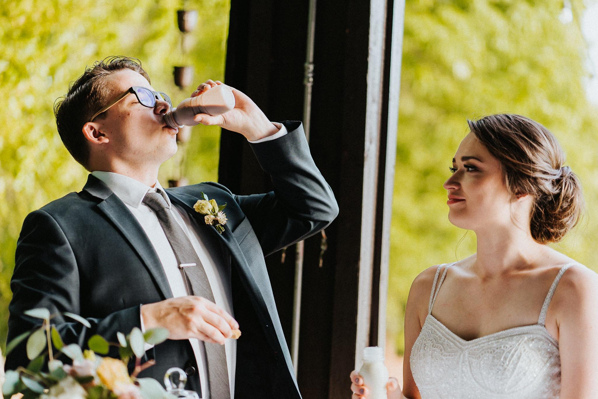 Groom drink milk cut cake wedding reception