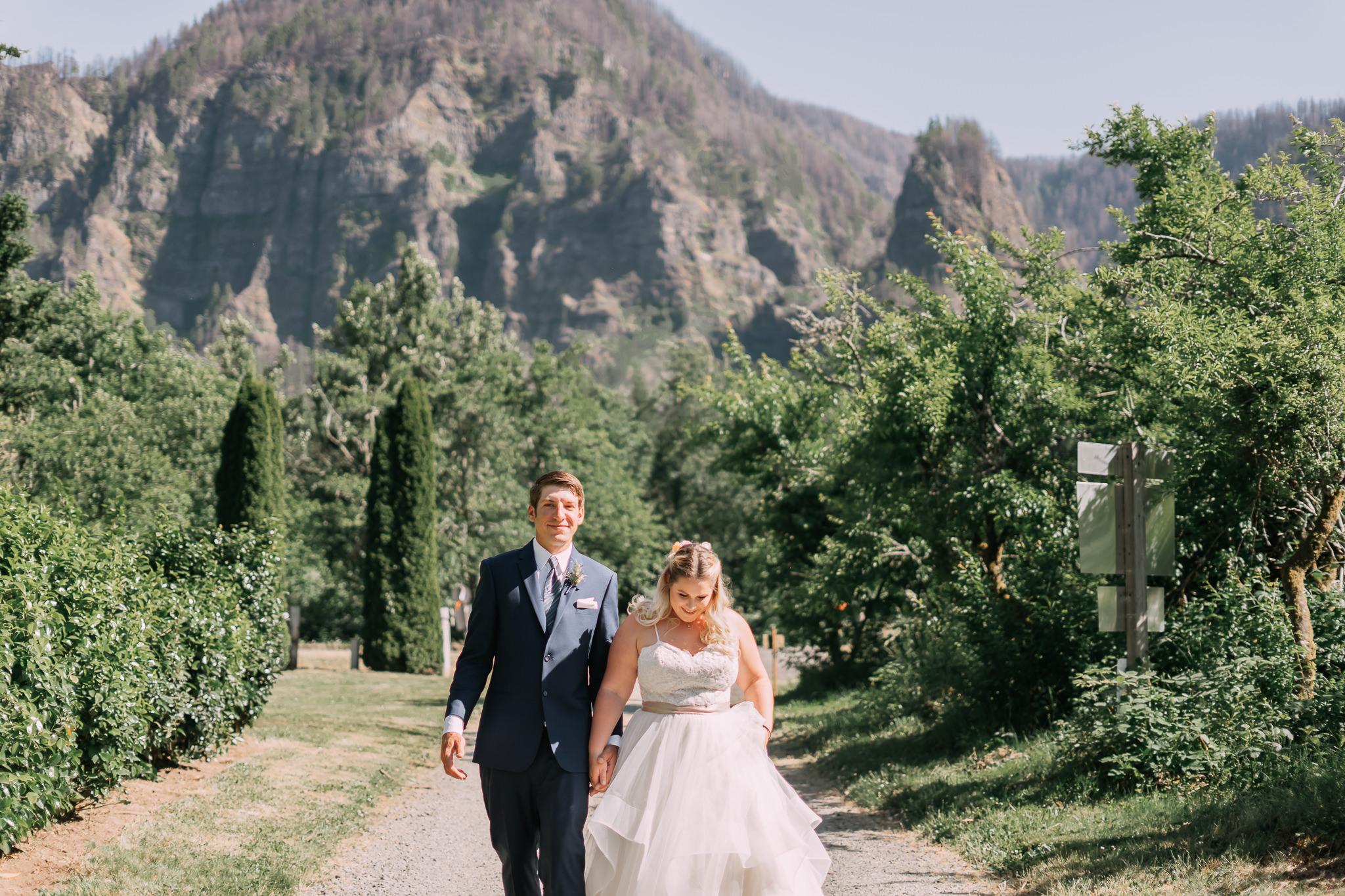 Wedding First Look Hug Kiss Columbia River Gorge Cliffside Cascade Locks walking
