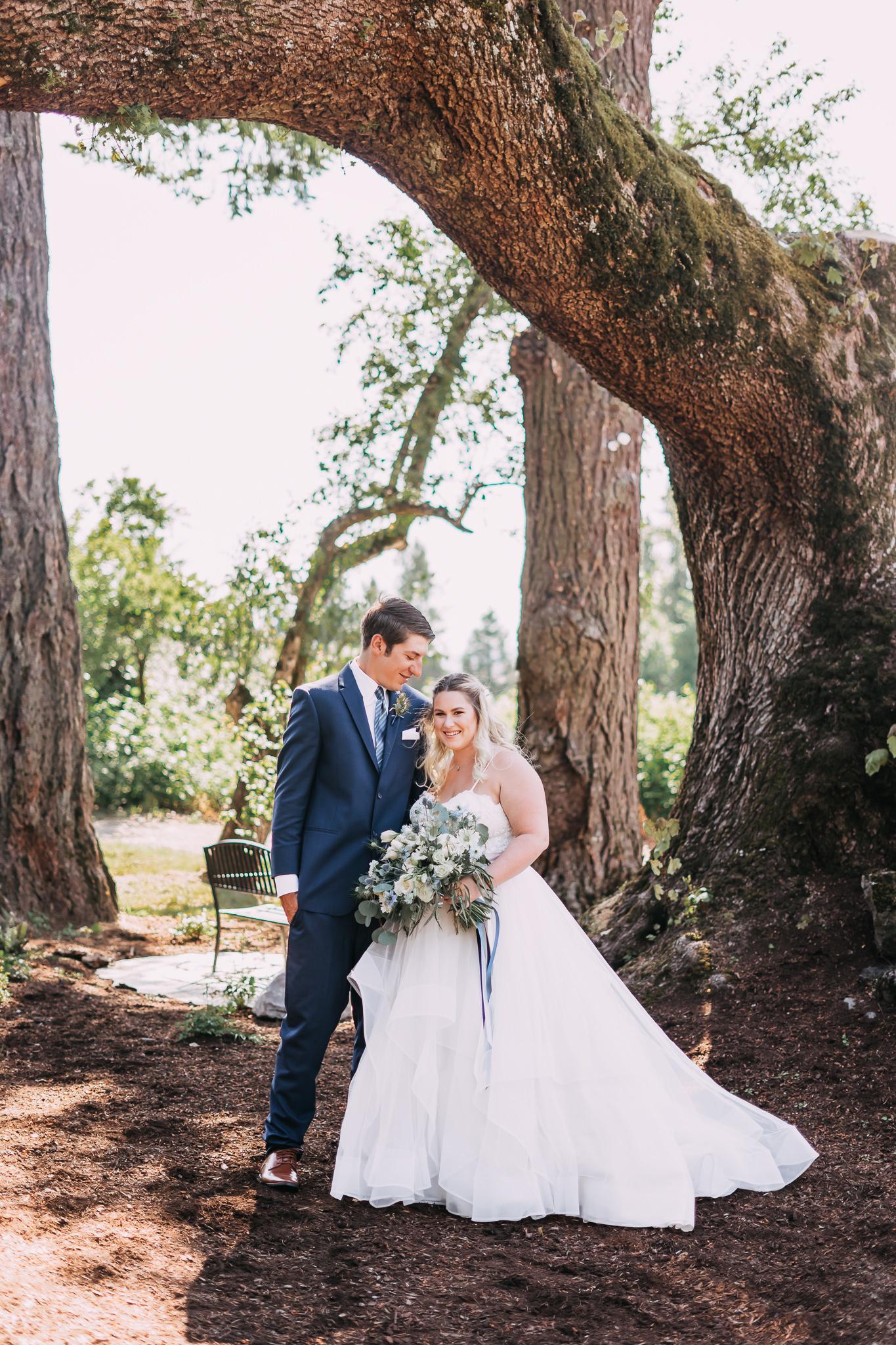 Vertical portrait mode bride groom formal wedding shoot
