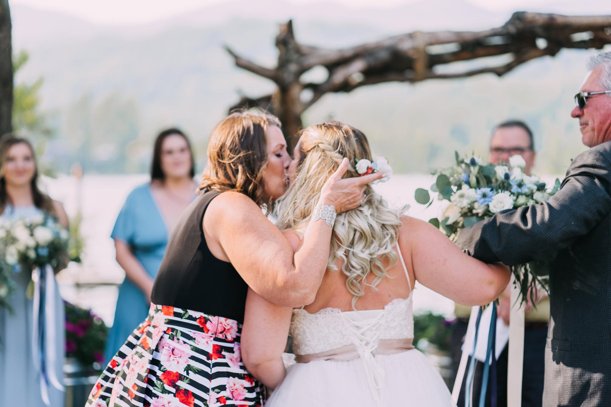 Mother kiss bride hand off wedding Oregon Portland backyard