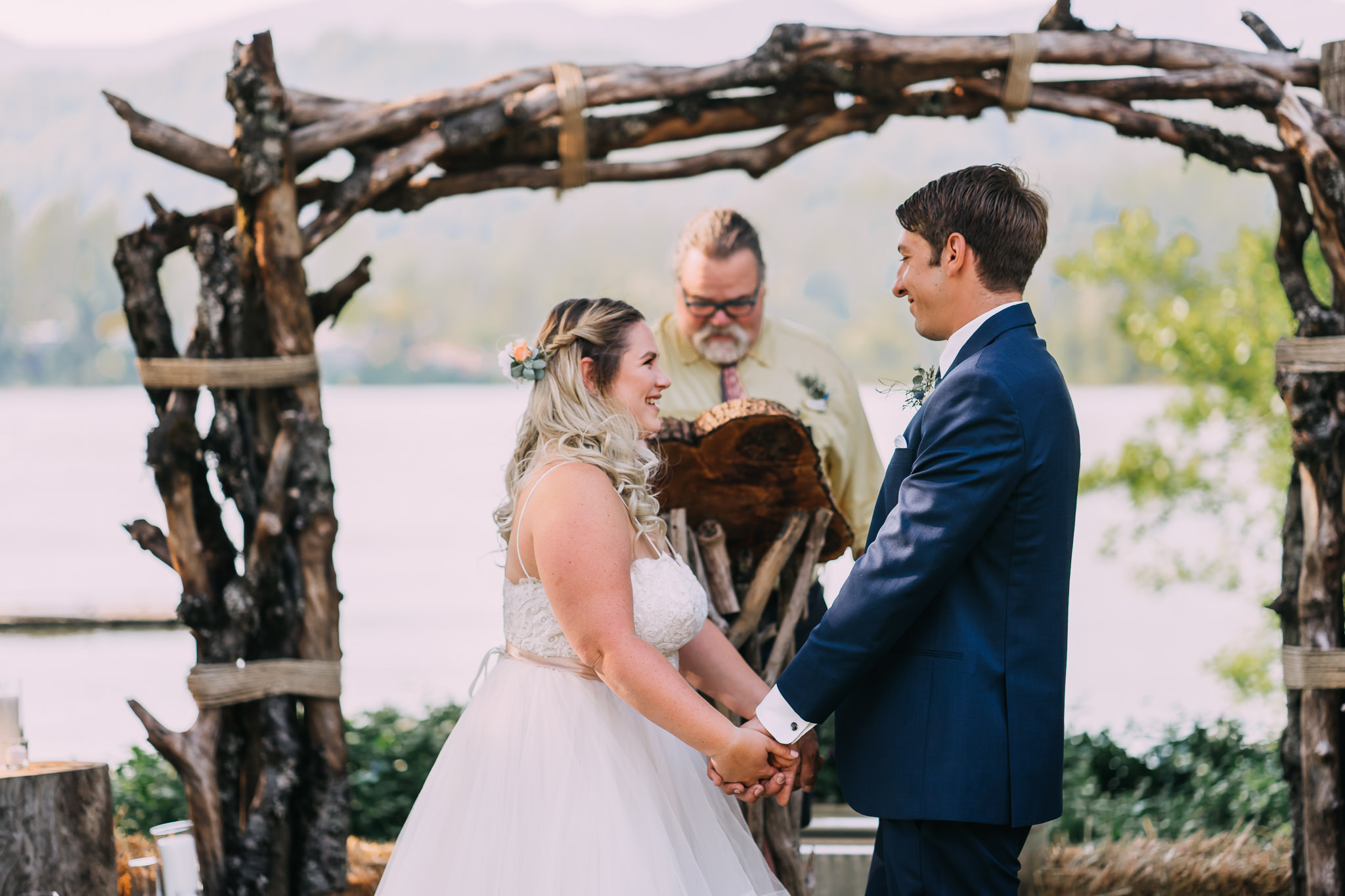 bride smile hold groom's hand ceremony Oregon Portland Wedding Photographer