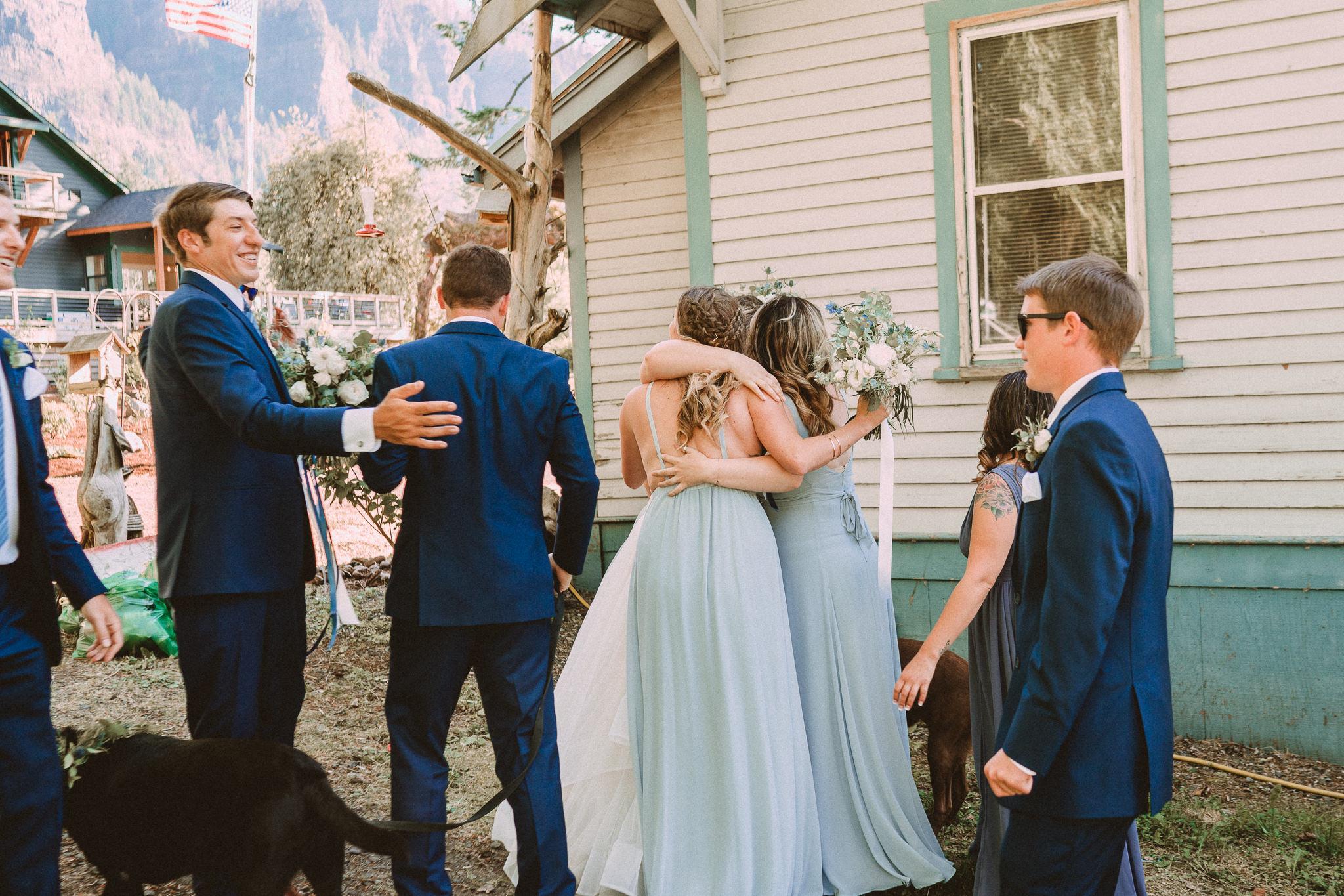 post ceremony Bridesmaid hug bride groomsmen wedding party Photographer Best of