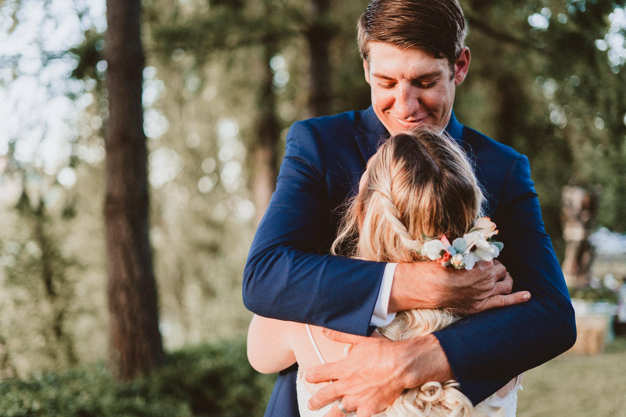 Groom hug bride sunset exposure wedding photography