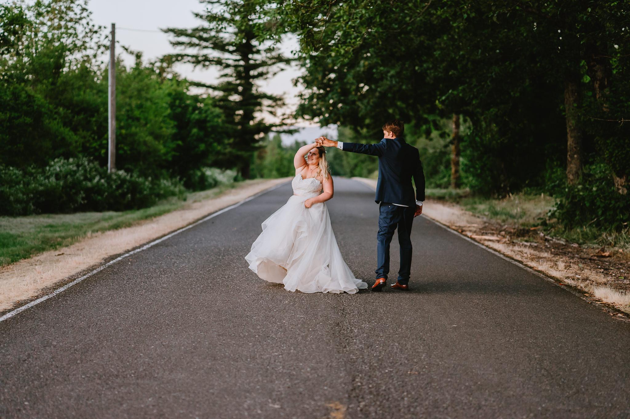 Groom twirl bride dress flow sunset Portland Oregon Wedding Photographer Alfred Tang