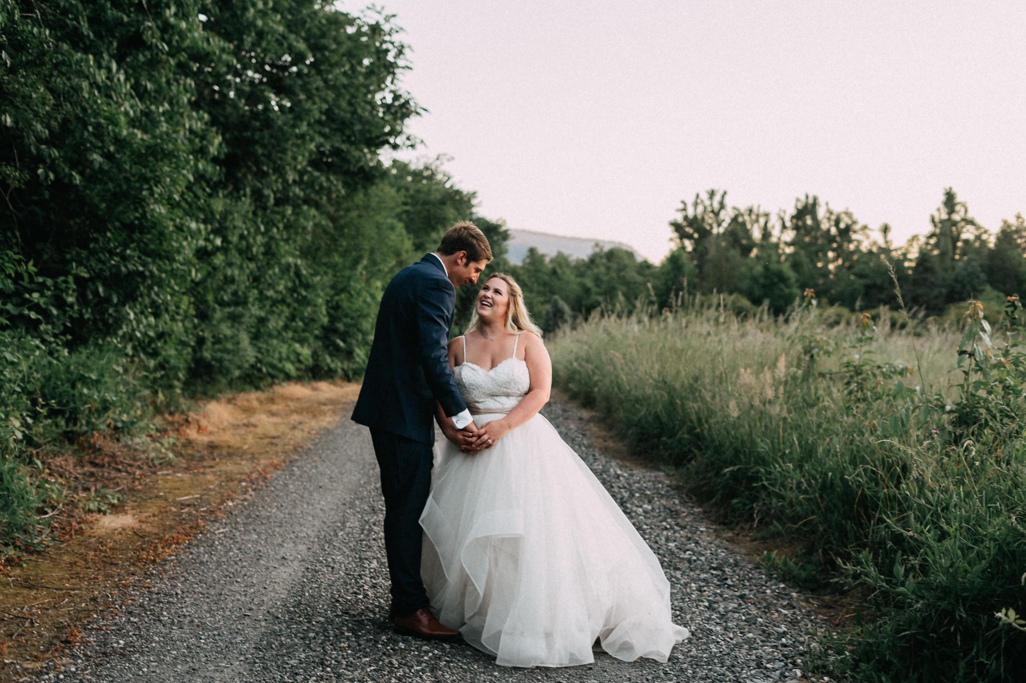 Groom kiss Bride Blue Suit Wedding Photography Portland Oregon
