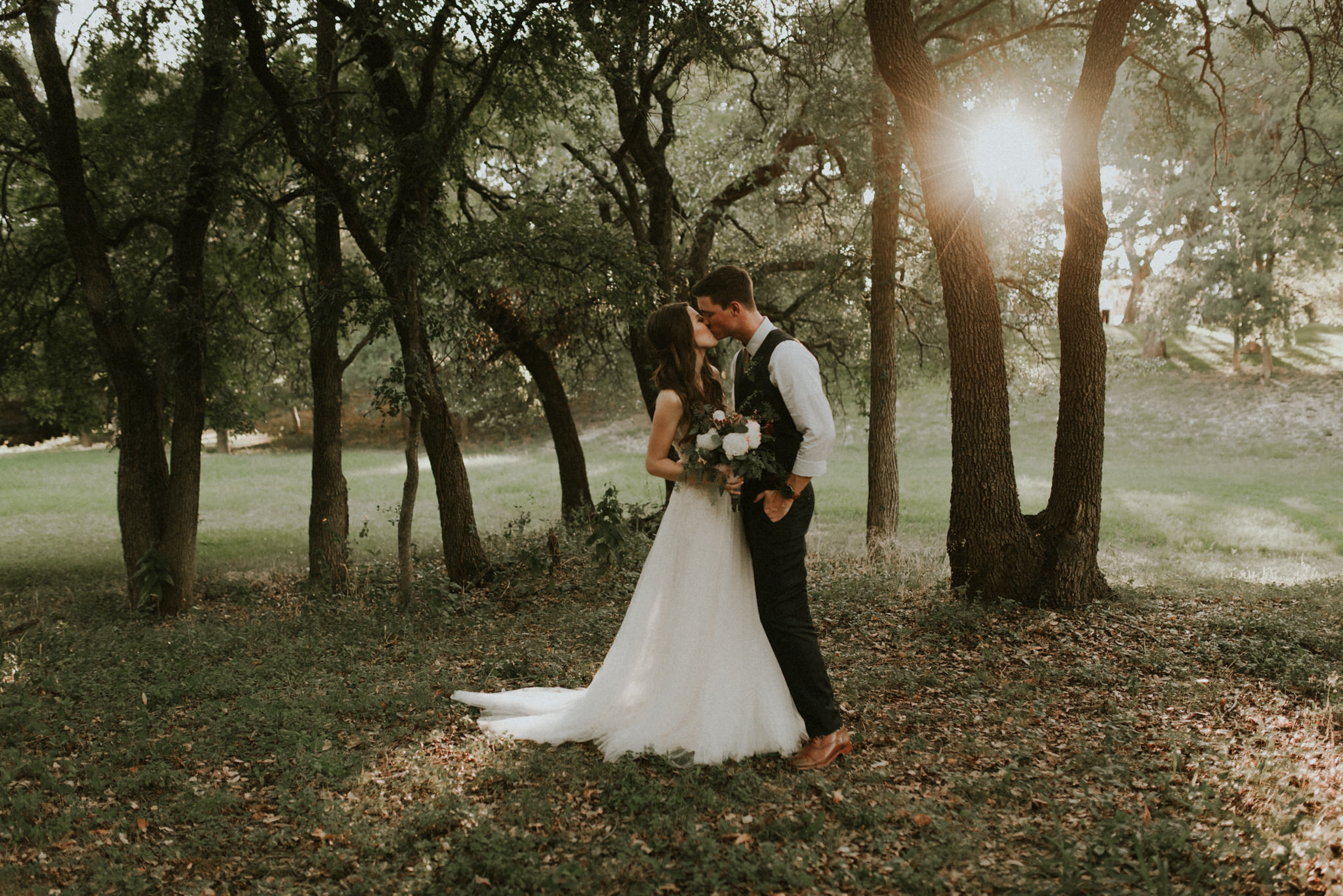 Intimate-Cathedral-Oaks-Wedding-Green-Oak-Forest-Floral-Archway-Lace-Wedding-Dress-Kerlyn-Van-Gelder-Photography-Austin-Wedding-Photographer