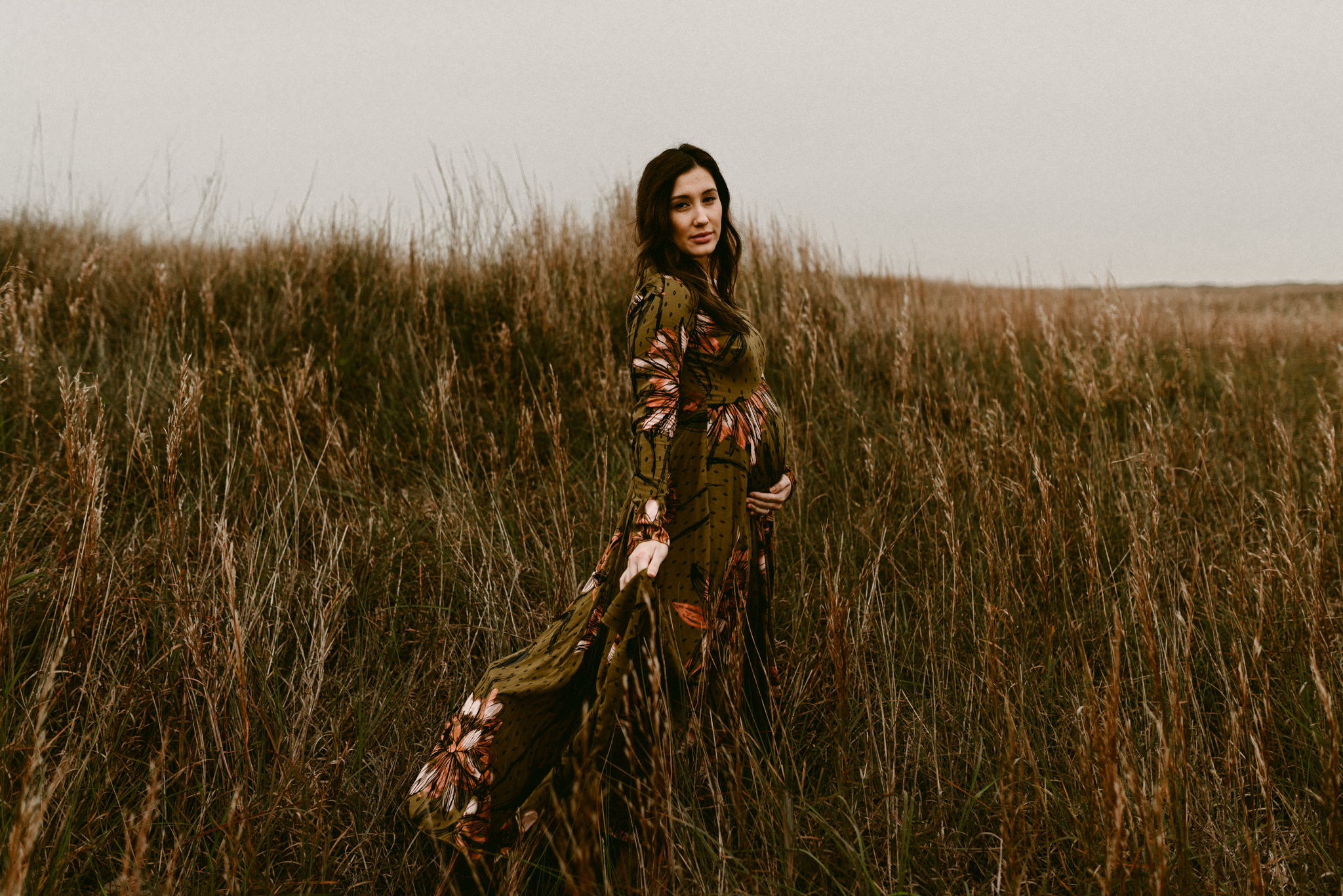 emotive-intimate-moody-maternity-session-on-padre-island-in-corpus-christi-flowing-dresses-loving-couple-grassy-fields-kerlyn-van-gelder-photography-corpus-christi-photographer