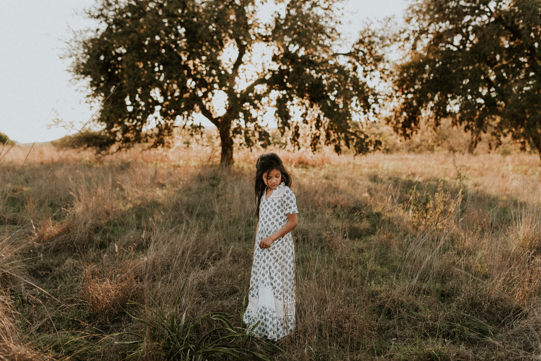 sunny-grassy-hills-filly-boo-family-maternity-session-at-joshua-springs-kerlyn-van-gelder-photography-san-antonio-photographer