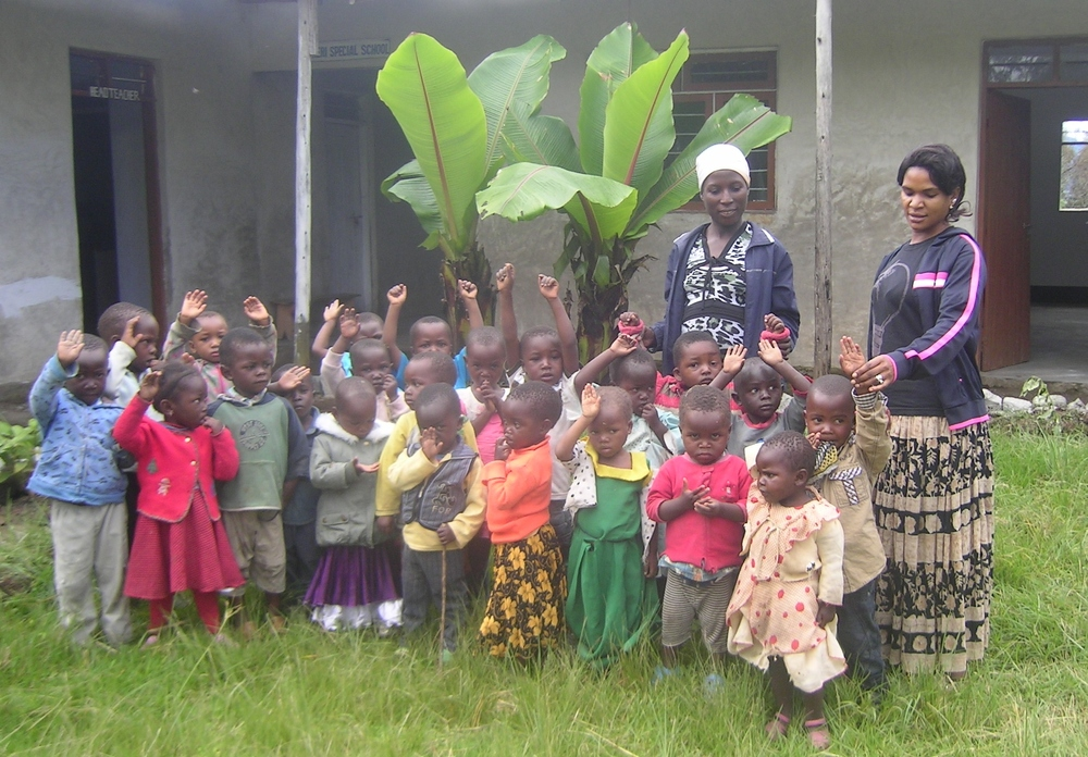 Some of the children at Heri Special School, with two of their teachers, photo taken in 2015.