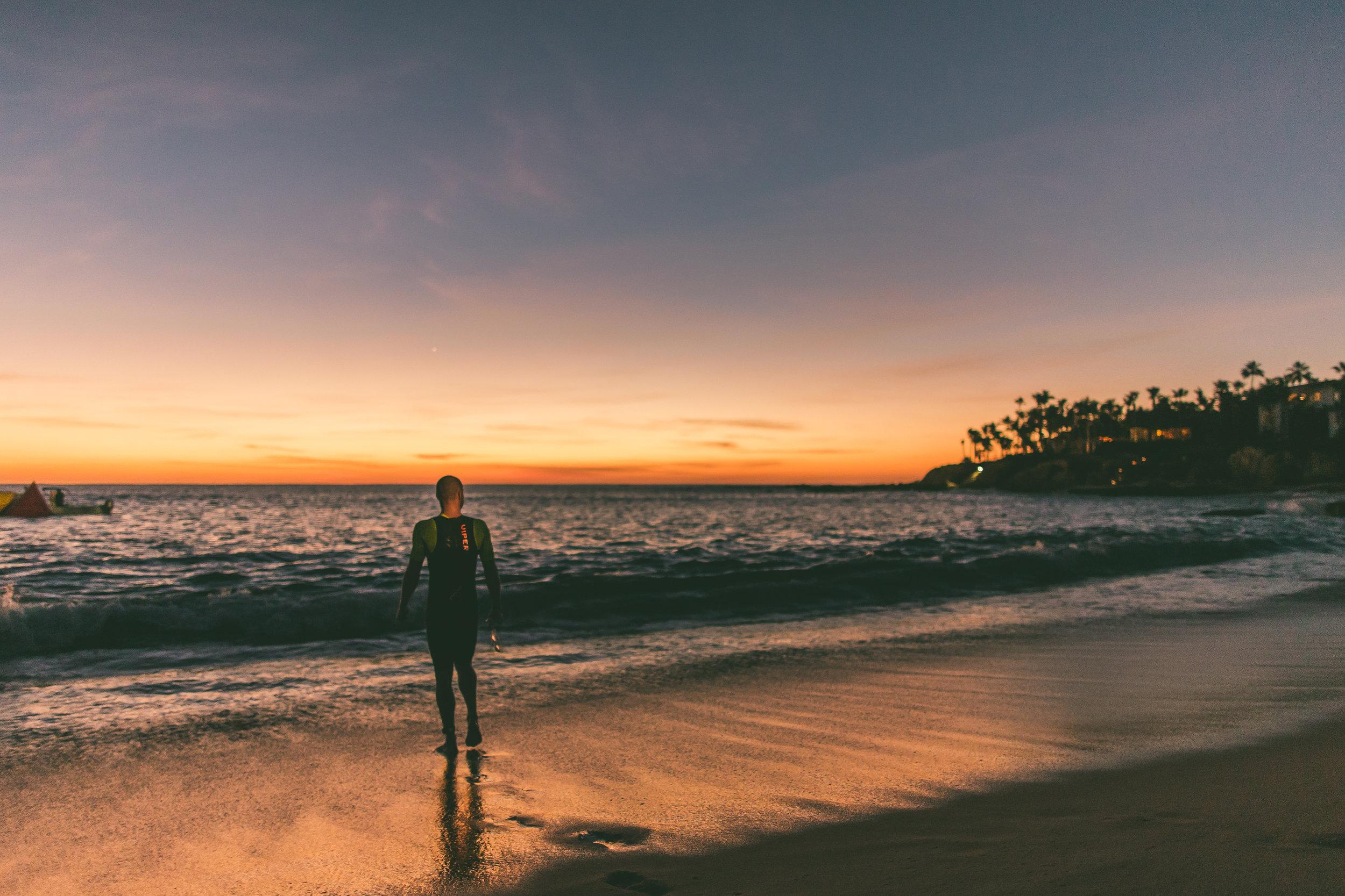 Luke Mckenzie at the waters edge on sunrise.