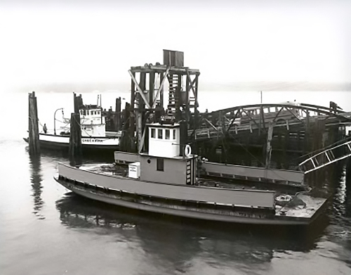 Chief Kwina  in dock with school bus on ramp,  Acorn  in reserve
