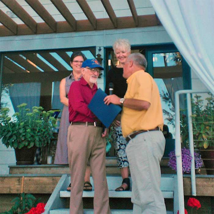 """Whatcom County Executive Jack Louws recognizes Paul with """"Paul Davis Day"""" on August 7, 2013."""