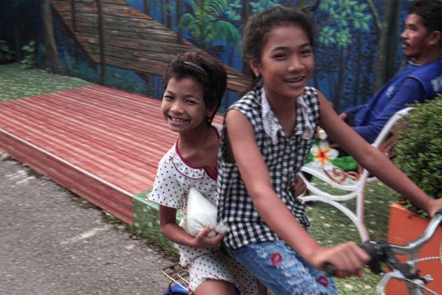Kids Cruising on a Bike.jpg
