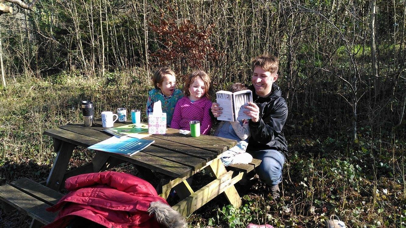 Jamie reading some Gardeners a fairy tale