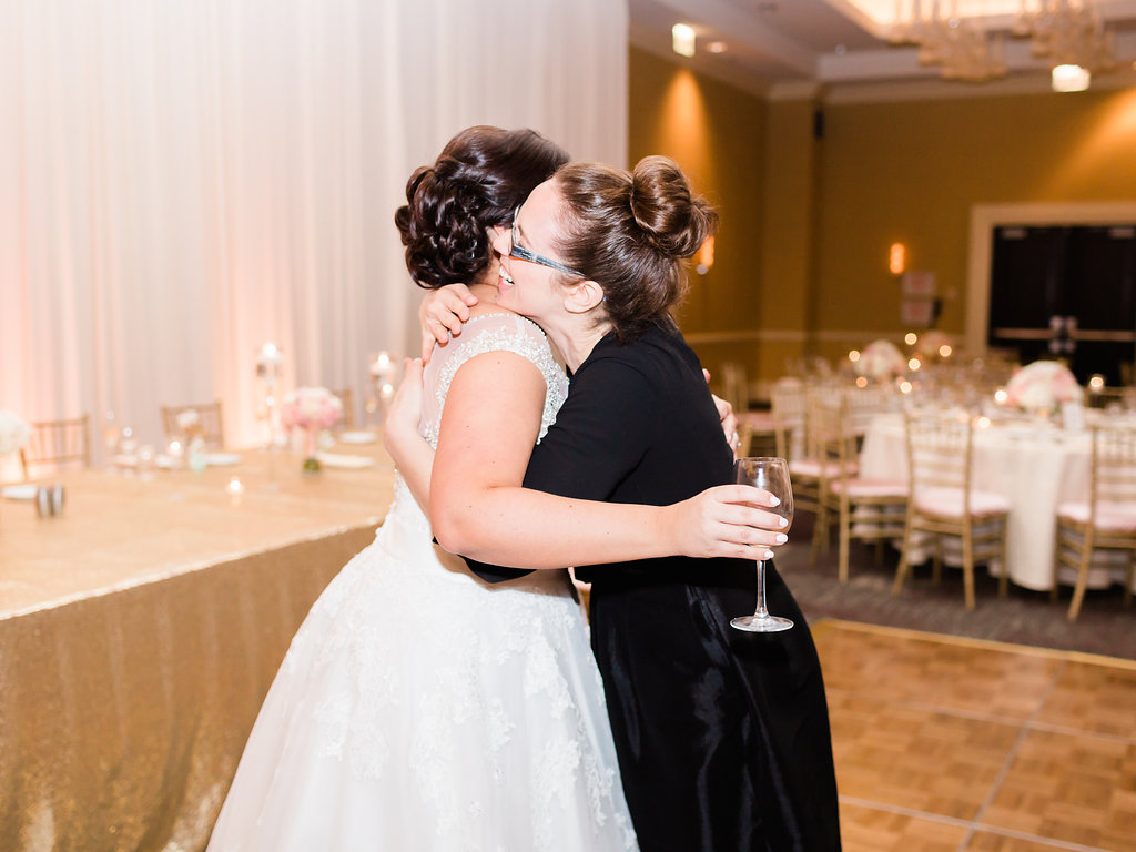 Maggie and lead Chicago planner, Elisa shared this embrace after Maggie got a peek at the reception venue set-up.  Isn't it the cutest shot? You can see how happy Elisa is with Maggie's reaction!  Photography:   Giadore Photography  | Ceremony Venue:  Ascension Church  | Reception Venue:  Renaissance Chicago O'Hare Suites Hotel  | Florist/Decor:  AEG Productions  | Cake:  Old Mill Bakery  | Hair:   Beauty by   Jaide  | Make-Up:   Faux Glaux  | Music:  Amp DJ Services  | Transportation:  Absolute Dream Limo  | Planner: Elisa, Simply Elegant Chicago Office