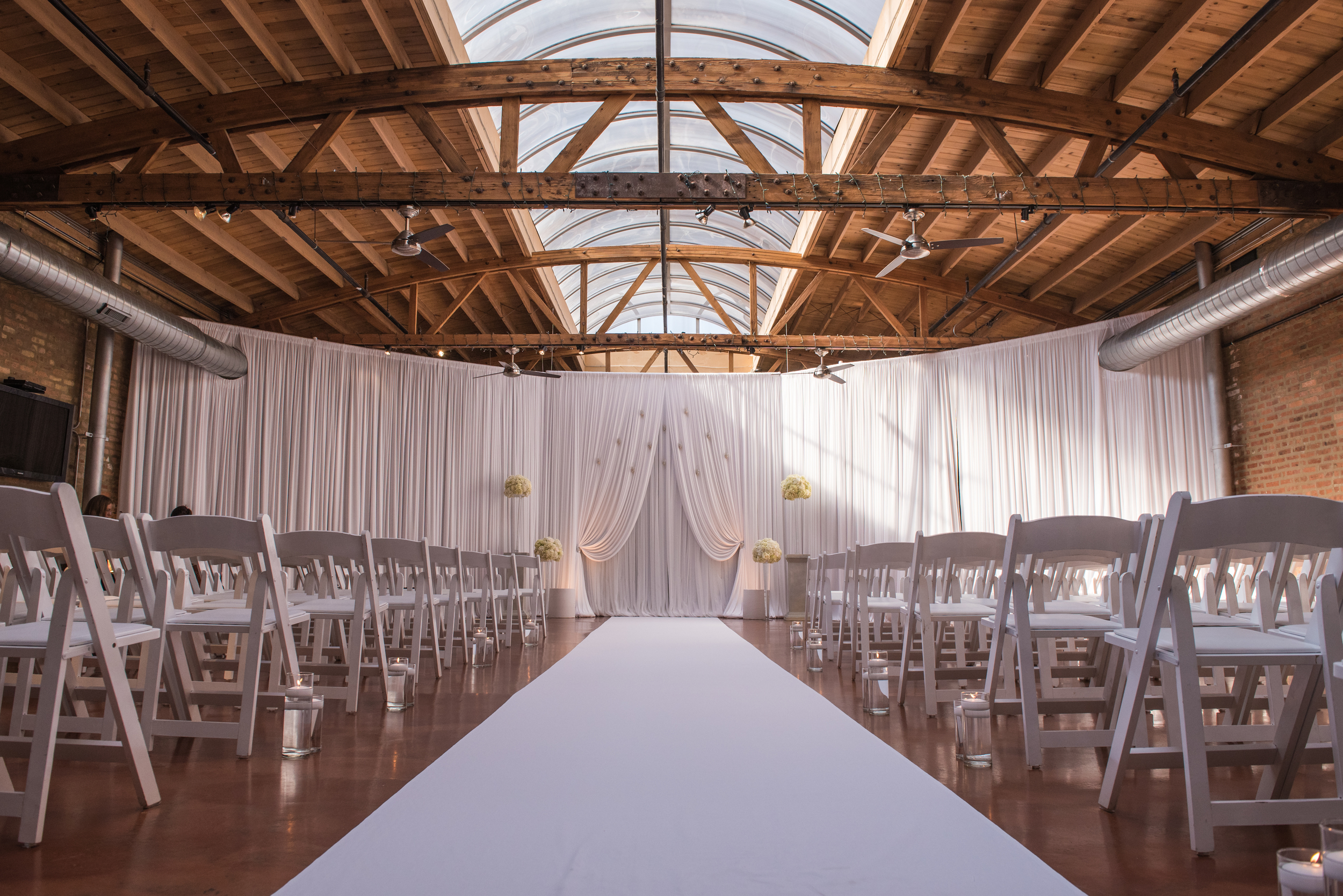 Venue:  Loft on Lake    Photography:  Thara Photo   Planning:  Elisa  , The Simply Elegant Group  Draping:  Art of Imagination    Floral:   Gratitude Heart Garden    Catering:  FireFly    Cake:  West Town Bakery   Bar:  Binny's   Reception:  Toast &Jam  Transportation:  Windy City Limo